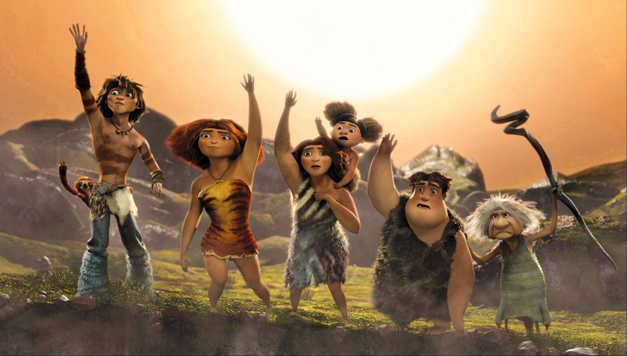 This film publicity image released by DreamWorks Animation shows, from left, Belt the sloth, voiced by Chris Sanders, Guy, voiced by Ryan Reynolds, Eep, voiced by Emma Stone, Ugga, voiced by Catherine Keener, holding Sandy, voiced by Randy Thom, Thunk, voiced by Clark Duke, Gran, voiced by Cloris Leachman, in a scene from �The Croods.� The 3-D film opened at No. 1 with $44.7 million.