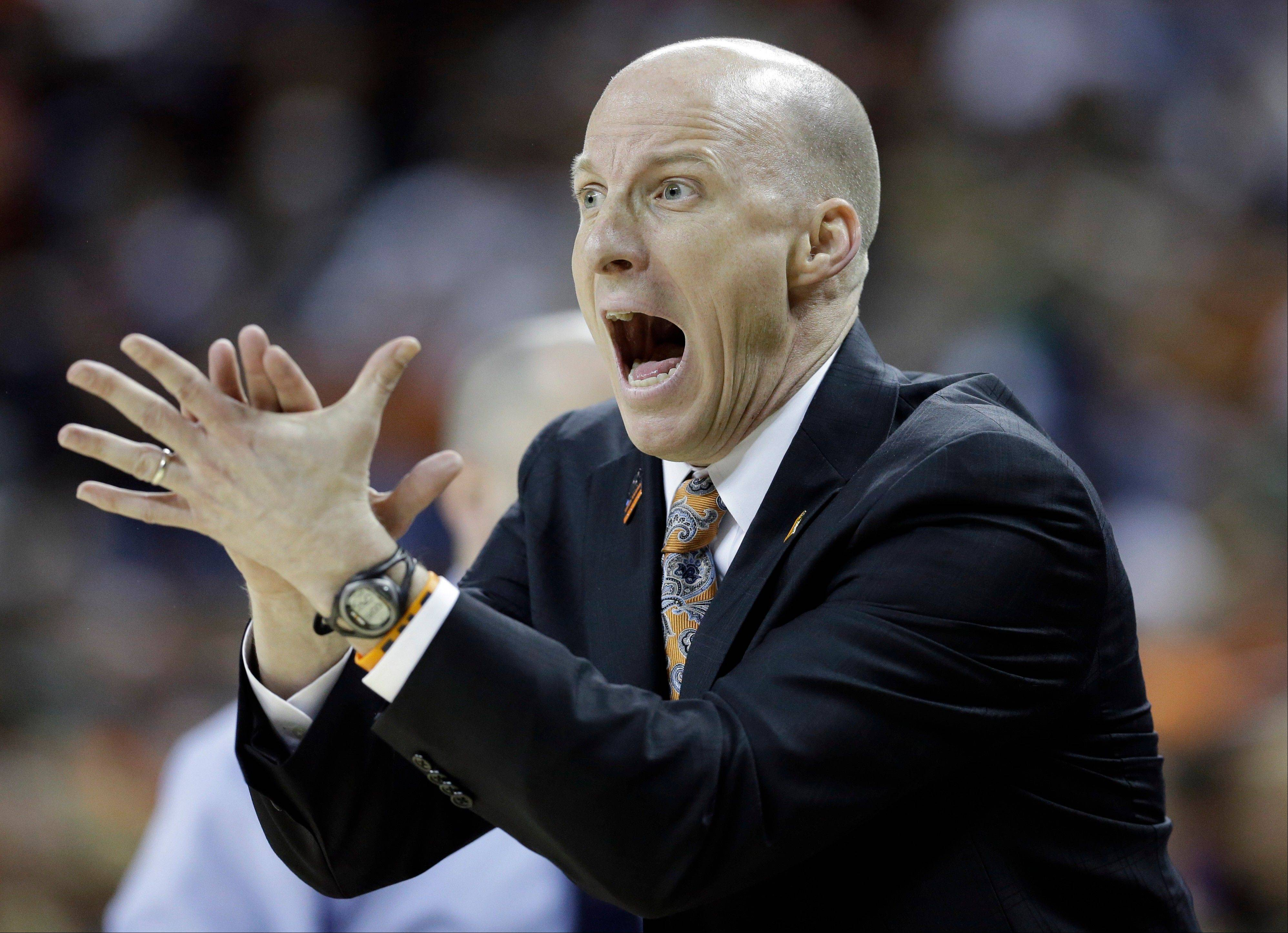 Illinois head coach John Groce reacts during the first half of a third-round game of the NCAA college basketball tournament against the Miami Sunday, March 24, 2013, in Austin, Texas.
