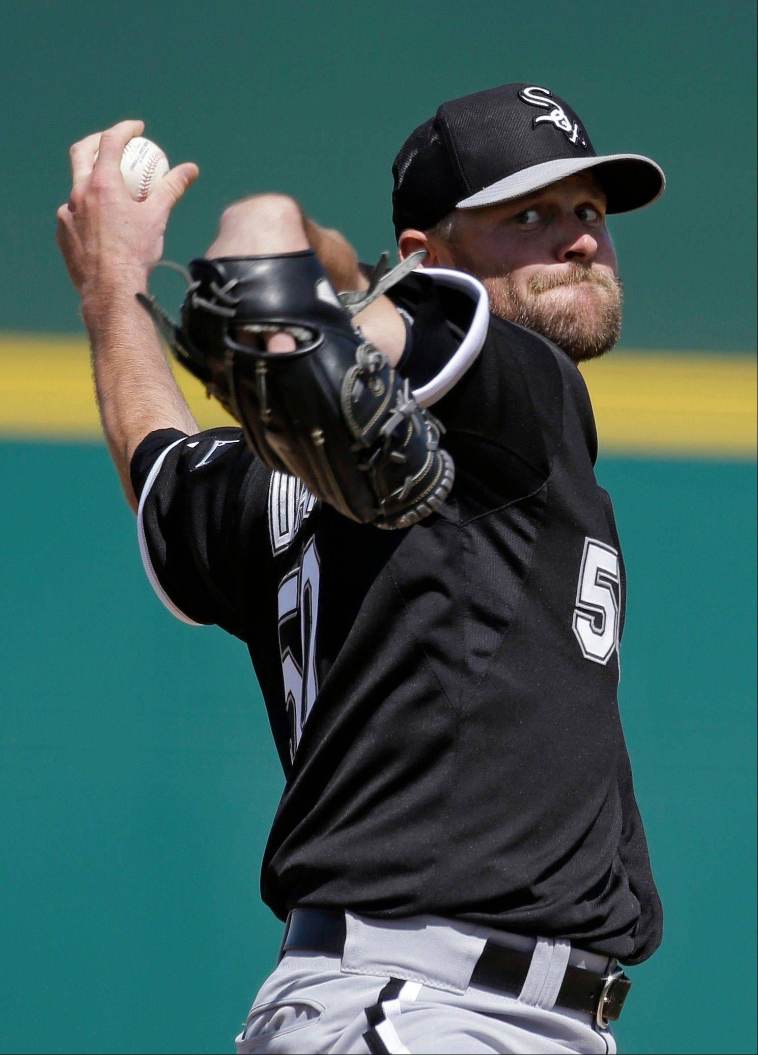 Chicago White Sox starting pitcher John Danks delivers against the Cincinnati Reds in the first inning of a spring training baseball game Tuesday, March 19, 2013, in Goodyear, Ariz.
