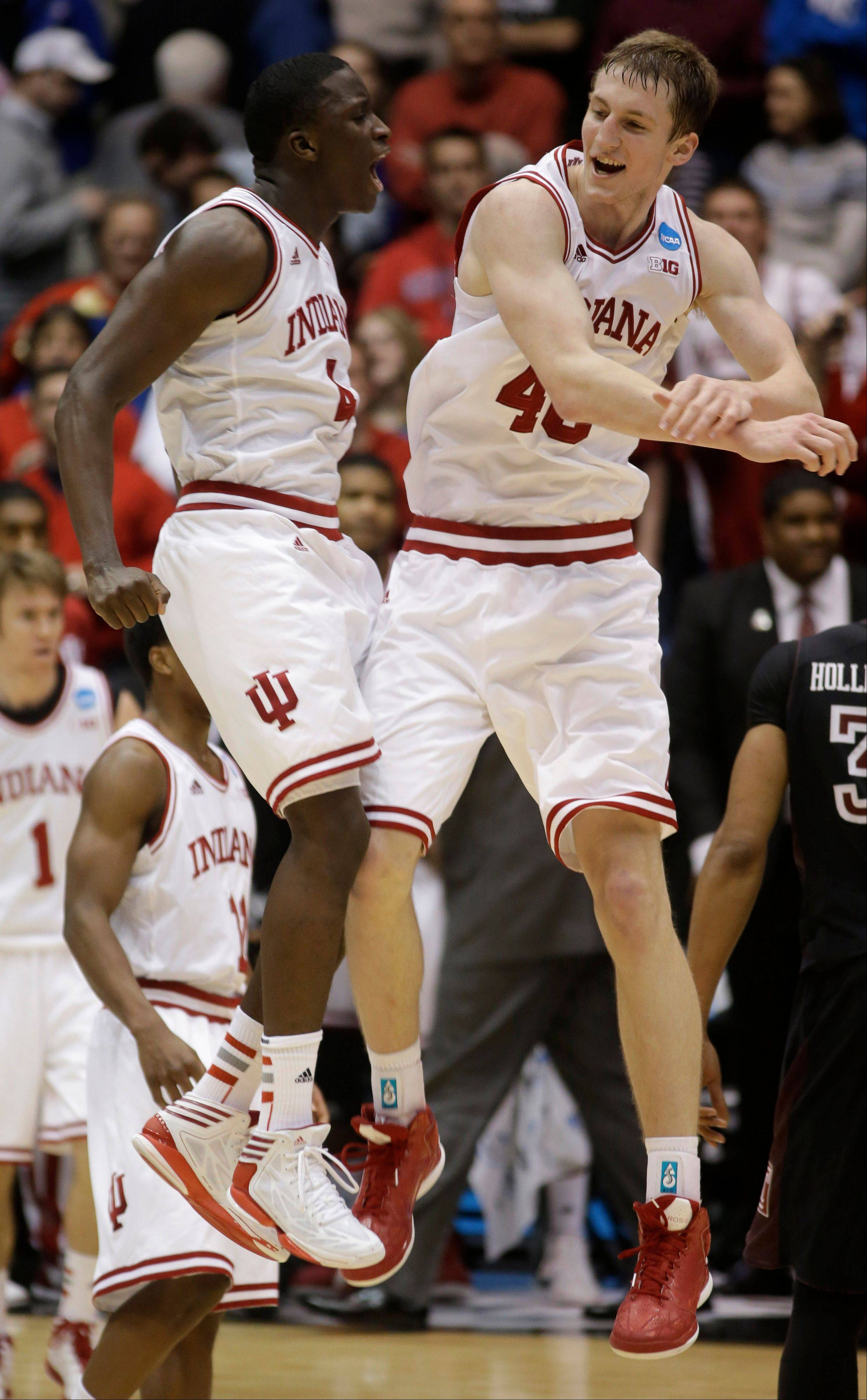 Indiana guard Victor Oladipo (4) and forward Cody Zeller celebrate after they defeated Temple 58-52 in a third-round game of the NCAA college basketball tournament Sunday March 24, 2013, in Dayton, Ohio.