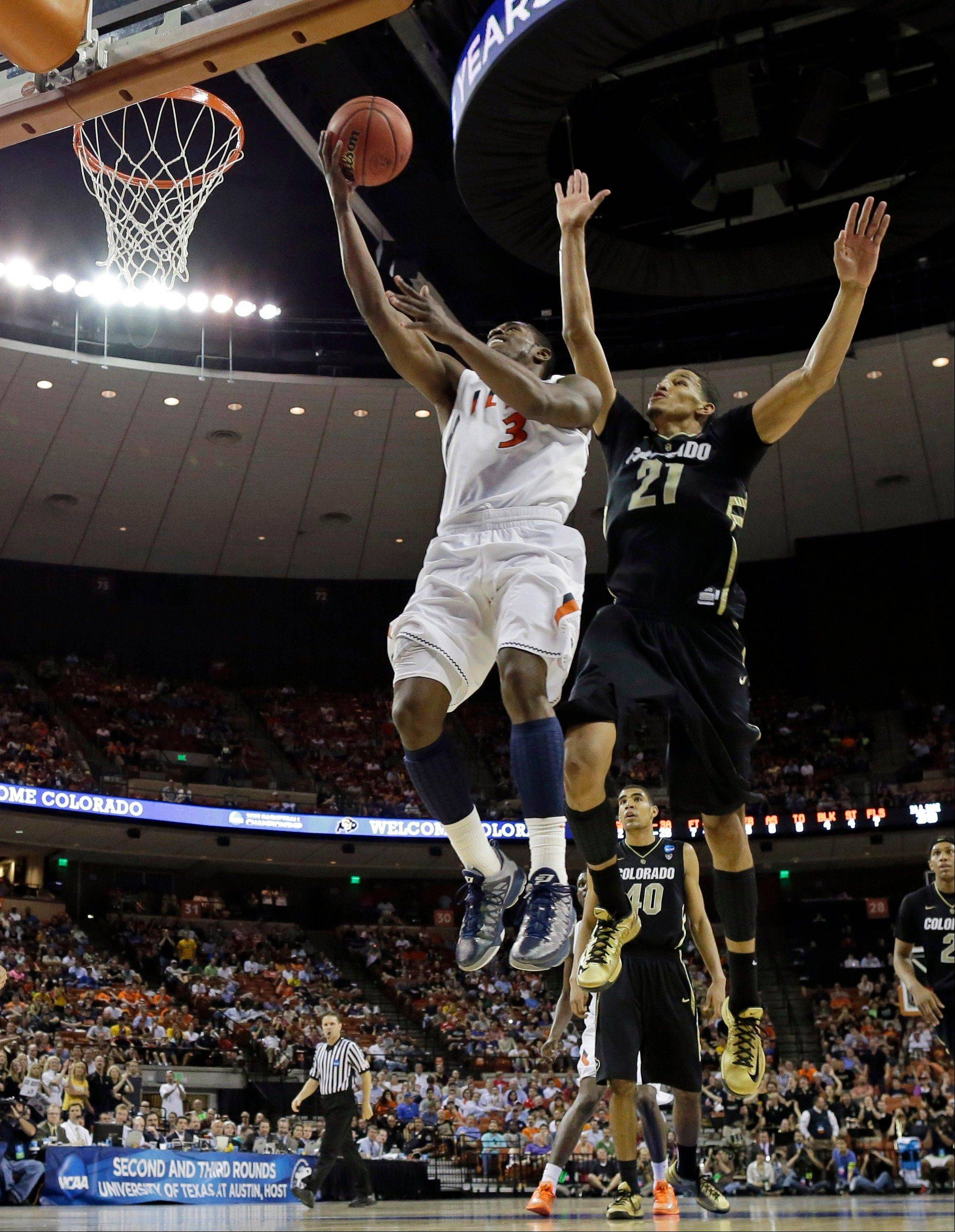 Illinois' Brandon Paul (3) goes up for a shot as Colorado's Andre Roberson (21) defends during the second half of a second-round game of the NCAA college basketball tournament Friday, March 22, 2013, in Austin, Texas. Illinois beat Colorado 57-49. (AP Photo/David J. Phillip)