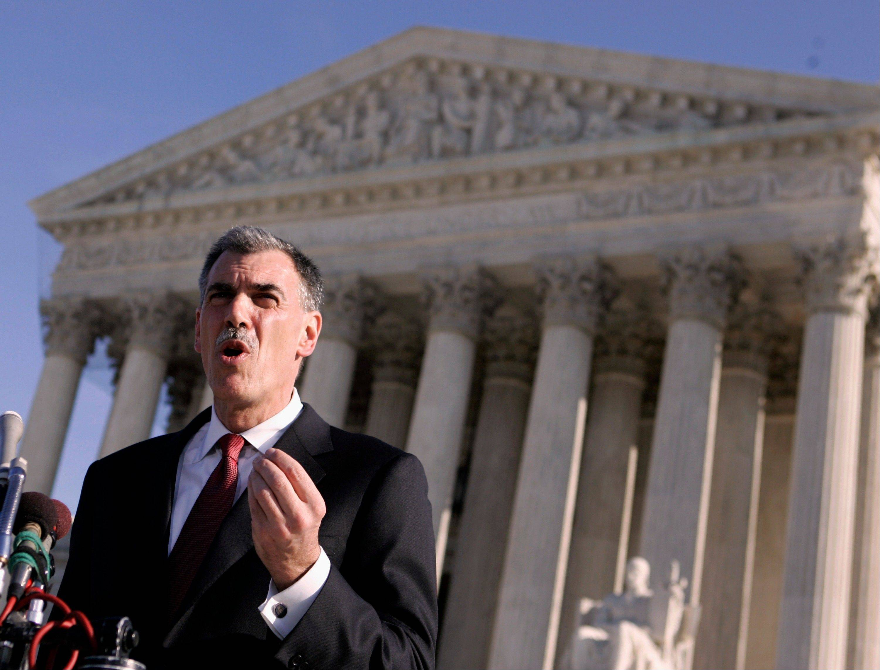 Then-Attorney Donald Verrilli talks to media outside the Supreme Court in 2008. Now President Barack Obama's top Supreme Court lawyer, Solicitor General Verilli, will argue before the Supreme Court this week whether it is legal for patent-holding pharmaceutical companies to pay rivals, who make generic drugs, to temporarily keep those cheaper versions of their brand-name drugs off the market.