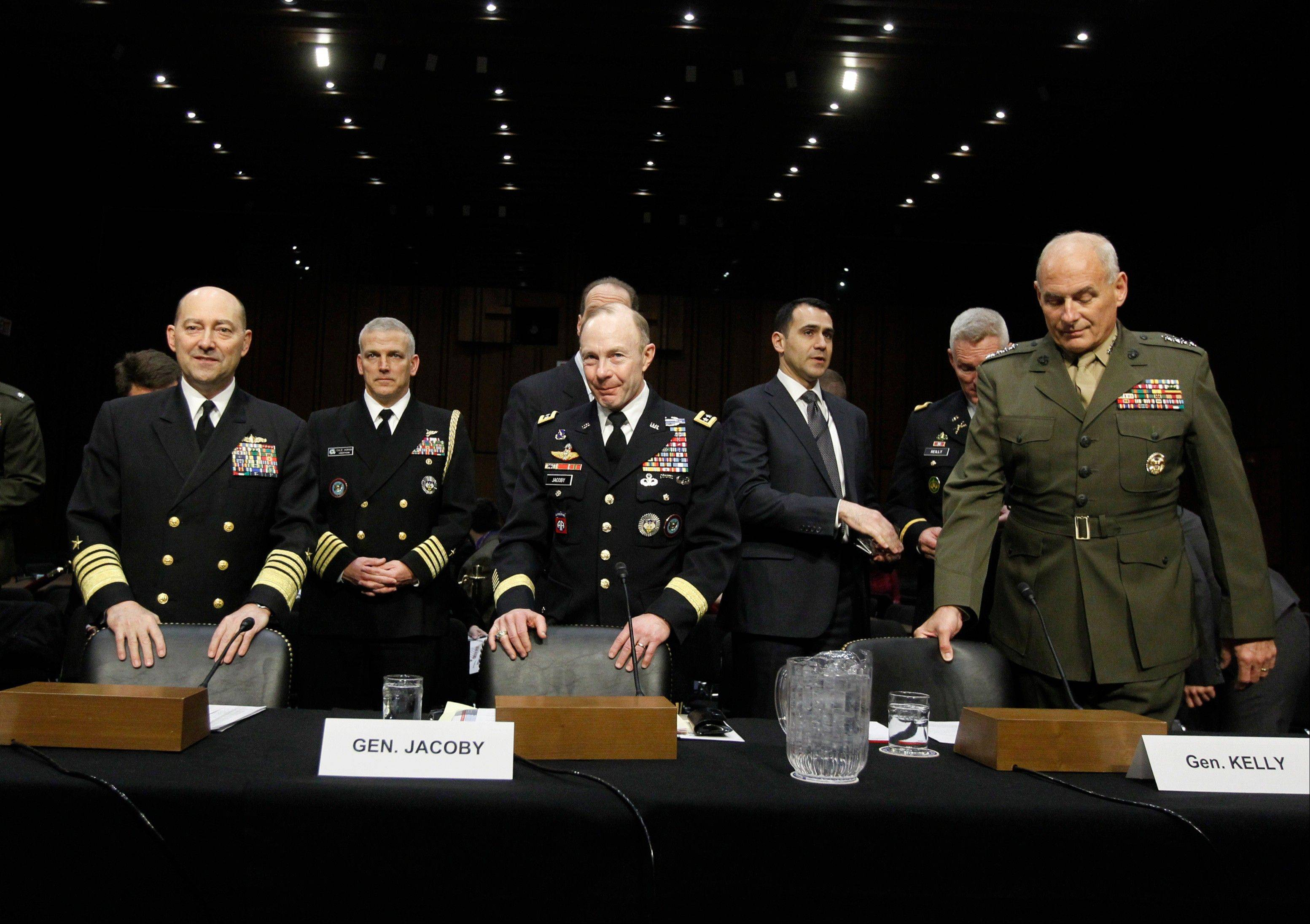 Front row, from left, Adm. James G. Stavridis, U.S. Navy Commander, U.S. European Command and Supreme Allied Commander, Europe; Gen. Charles H. Jacoby, Jr., Commander, U.S. Northern Command and Commander, North American Aerospace Defense Command; and Gen. John F. Kelly, USMC, Commander, U.S. Southern Command on Capitol Hill in Washington.