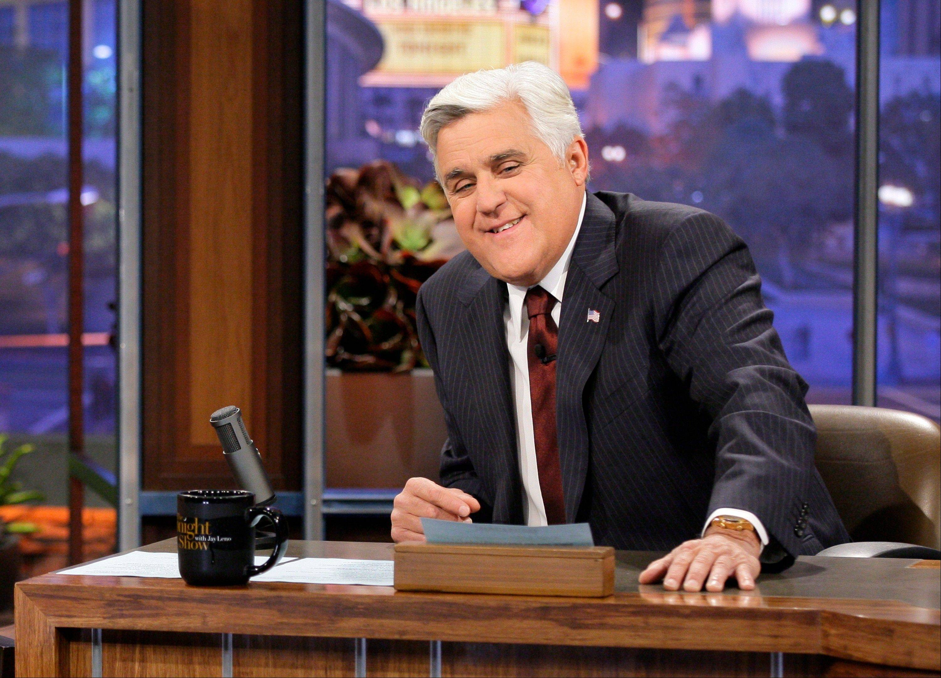 "This Nov. 5, 2012 photo released by NBC shows Jay Leno, host of ""The Tonight Show with Jay Leno,"" on the set in Burbank, Calif. Leno has been very vocal in recent weeks of his lack of love for NBC over news they're replacing him with Jimmy Fallon when his contract ends at the end of next year."