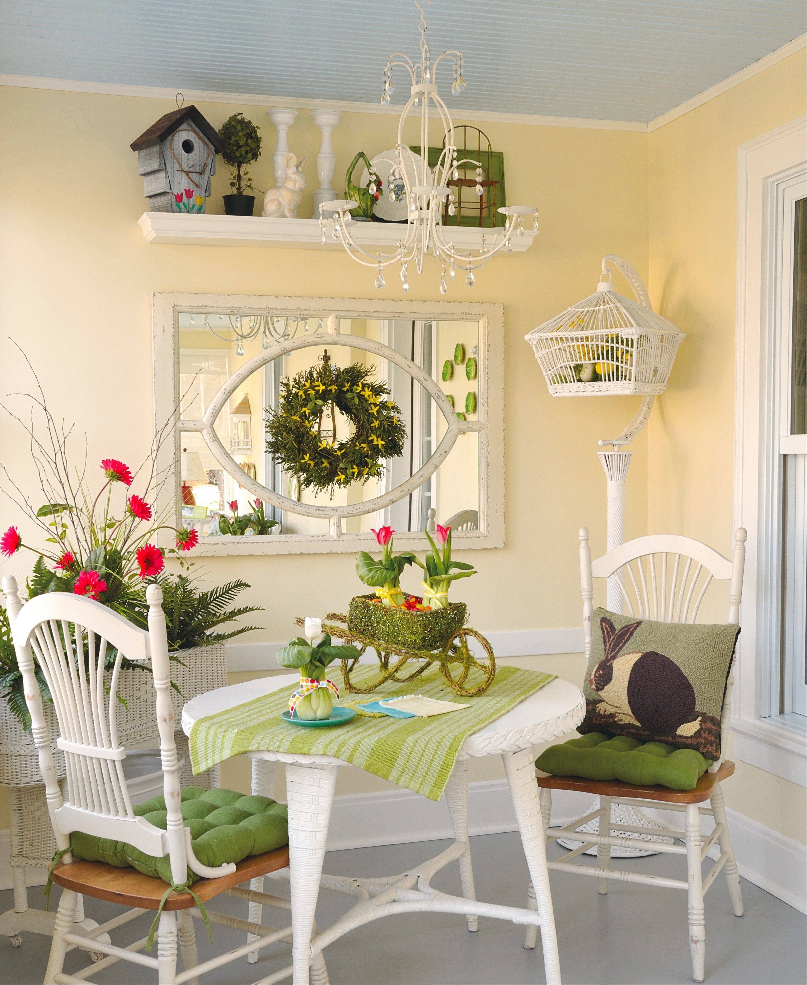 "Bright spots: Try a ""floating"" accent, such as the forsythia-dotted wreath attached to a salvage-style mirror."