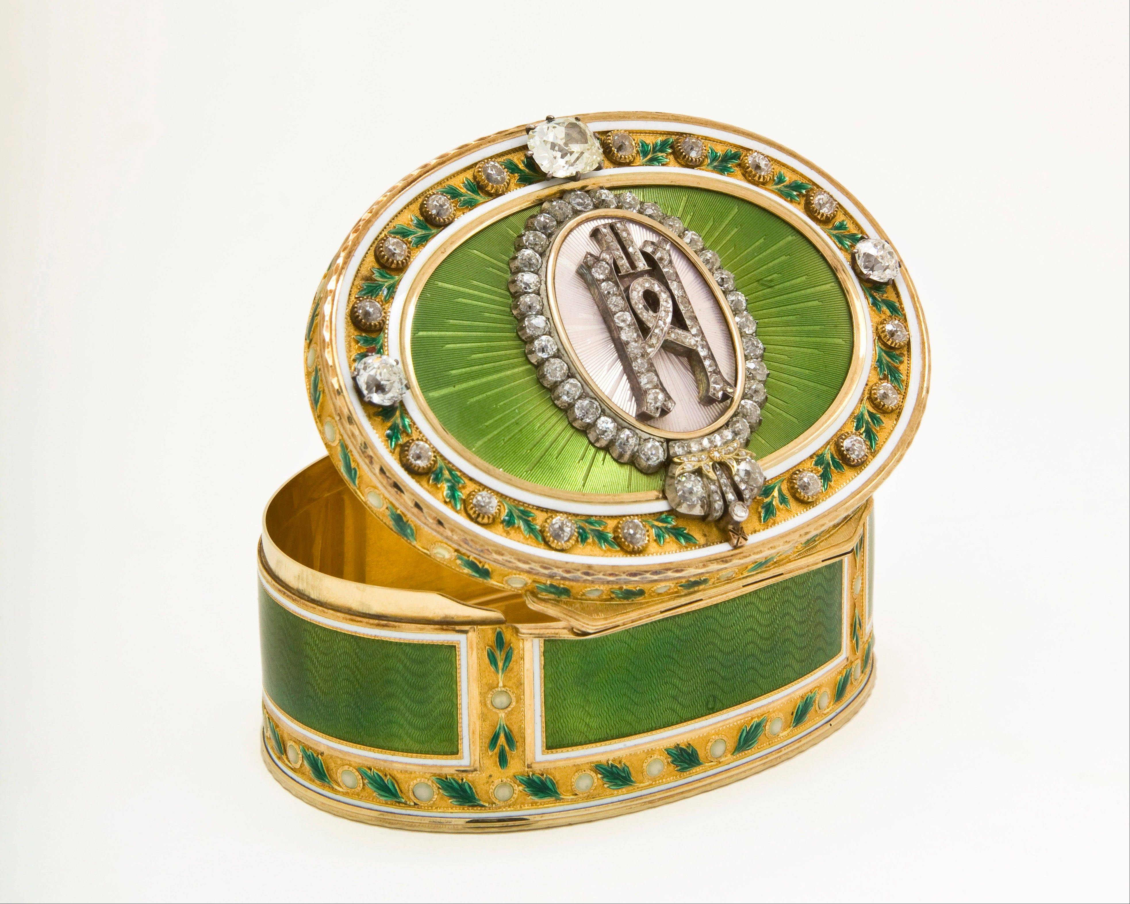 An imperial presentation box by Faberge workmaster Mikhail Perkhin is shown at the Houston Museum of Natural Science.