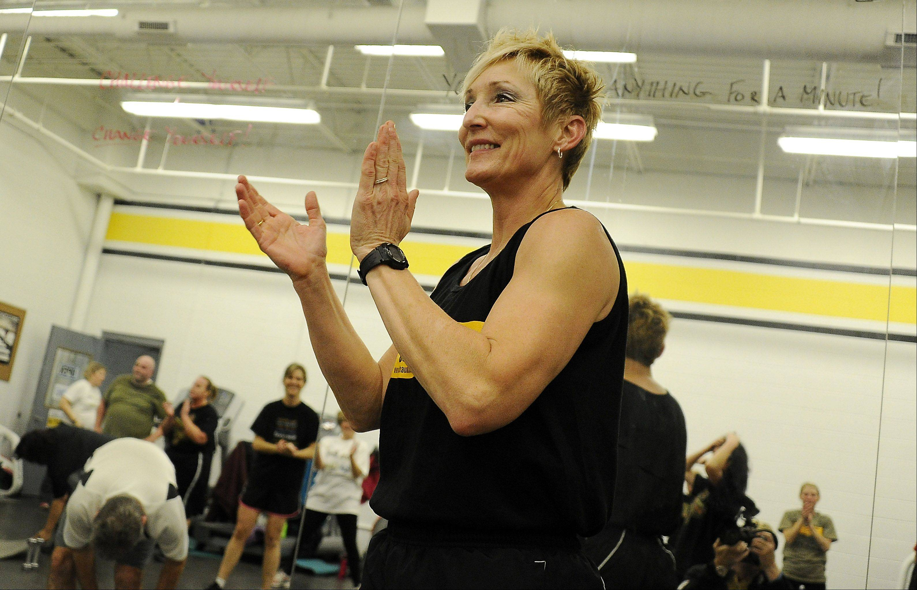 Retired Illinois State Police captain Tami Haukedahl cheers on her Train Like a Trooper Boot Camp as she whips suburban moms and dad into shape at the West Meadows Ice Arena in Rolling Meadows.