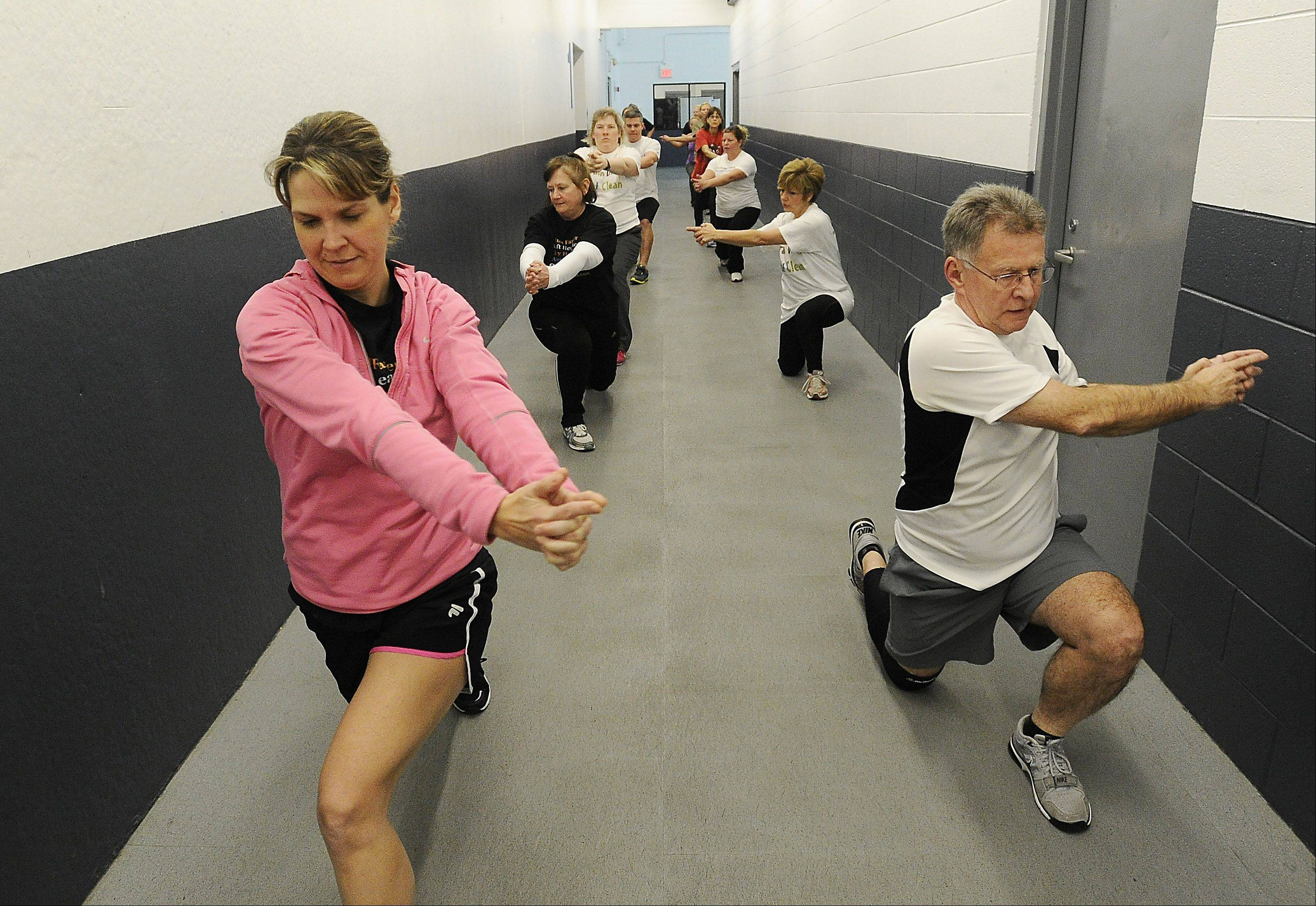 Members of the Train Like a Trooper Boot Camp, run by retired Illinois State Police captain Tami Haukedahl, of Arlington Heights, work out at the West Meadows Ice Arena in Rolling Meadows.