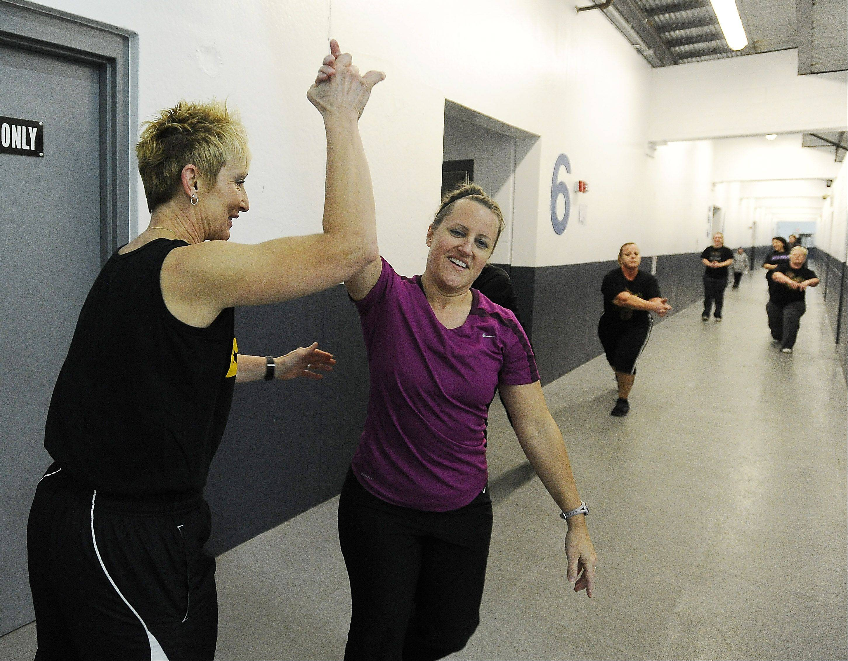 Retired Illinois State Police captain Tami Haukedahl cheers on her Train Like a Trooper Boot Camp members as she whips suburban moms and dad into shape at her Hauk Fitness gym in the West Meadows Ice Arena.
