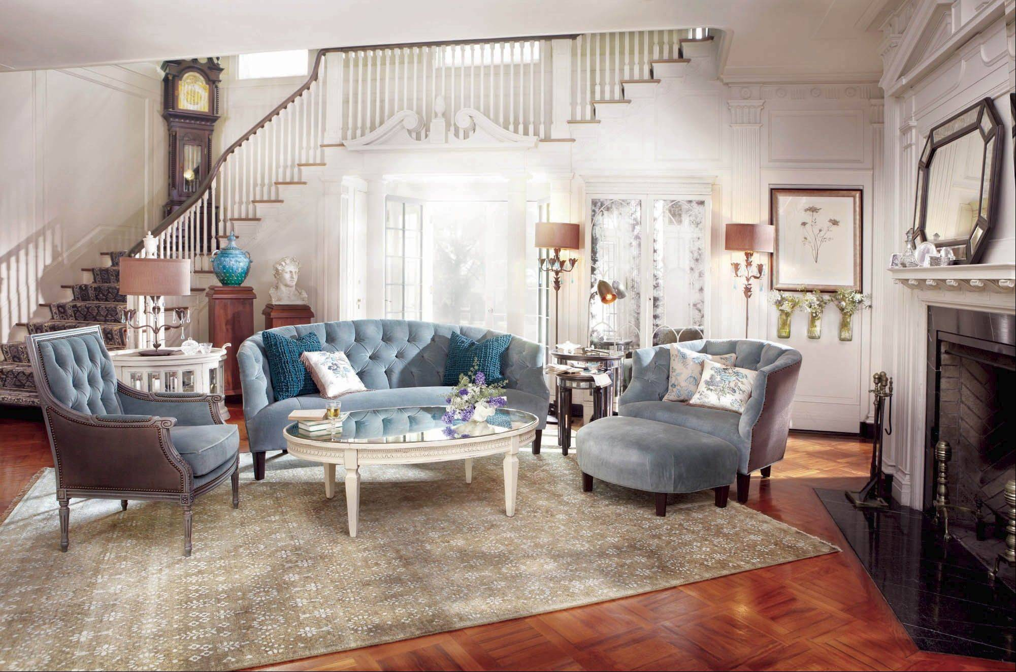 "Home decor lines this spring are being influenced by the Roaring Twenties and art deco; here the Arhaus Paloma parlor sofa in ""Cannes silver sage"" velvet frames the Amelia mirrored top coffee table."