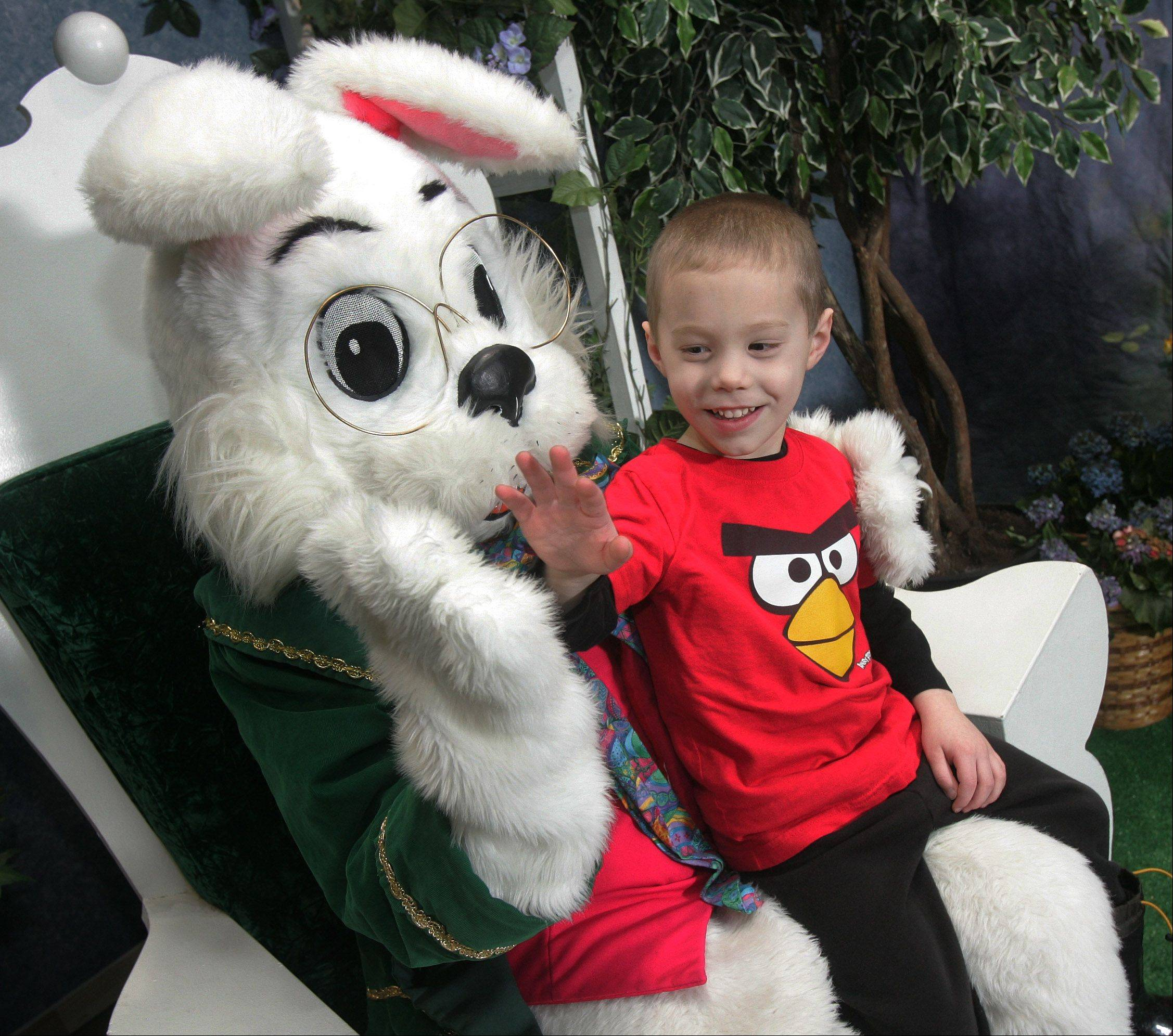 A.J. Garrity, 4, of Antioch, gives a high five to the Easter Bunny Monday in Grange Hall at Gurnee Mills. The Easter Bunny will be at he mall till March 30, Monday-Saturday from 11am-8pm and Sunday from 11am-6pm.