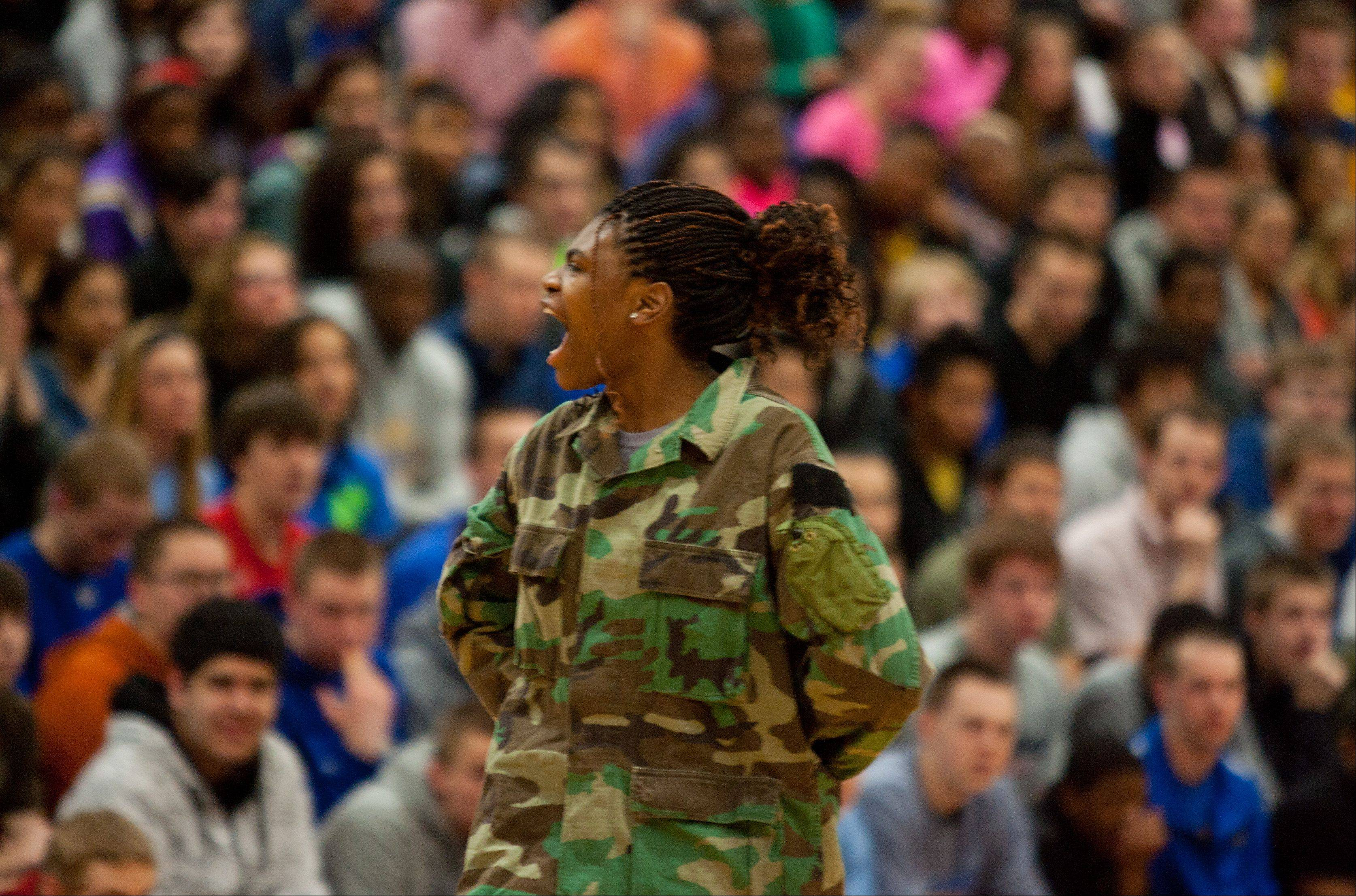 Janiece Robertson commands the Wheaton North Step team, as it celebrates its weekend state championship win, during a school assembly.