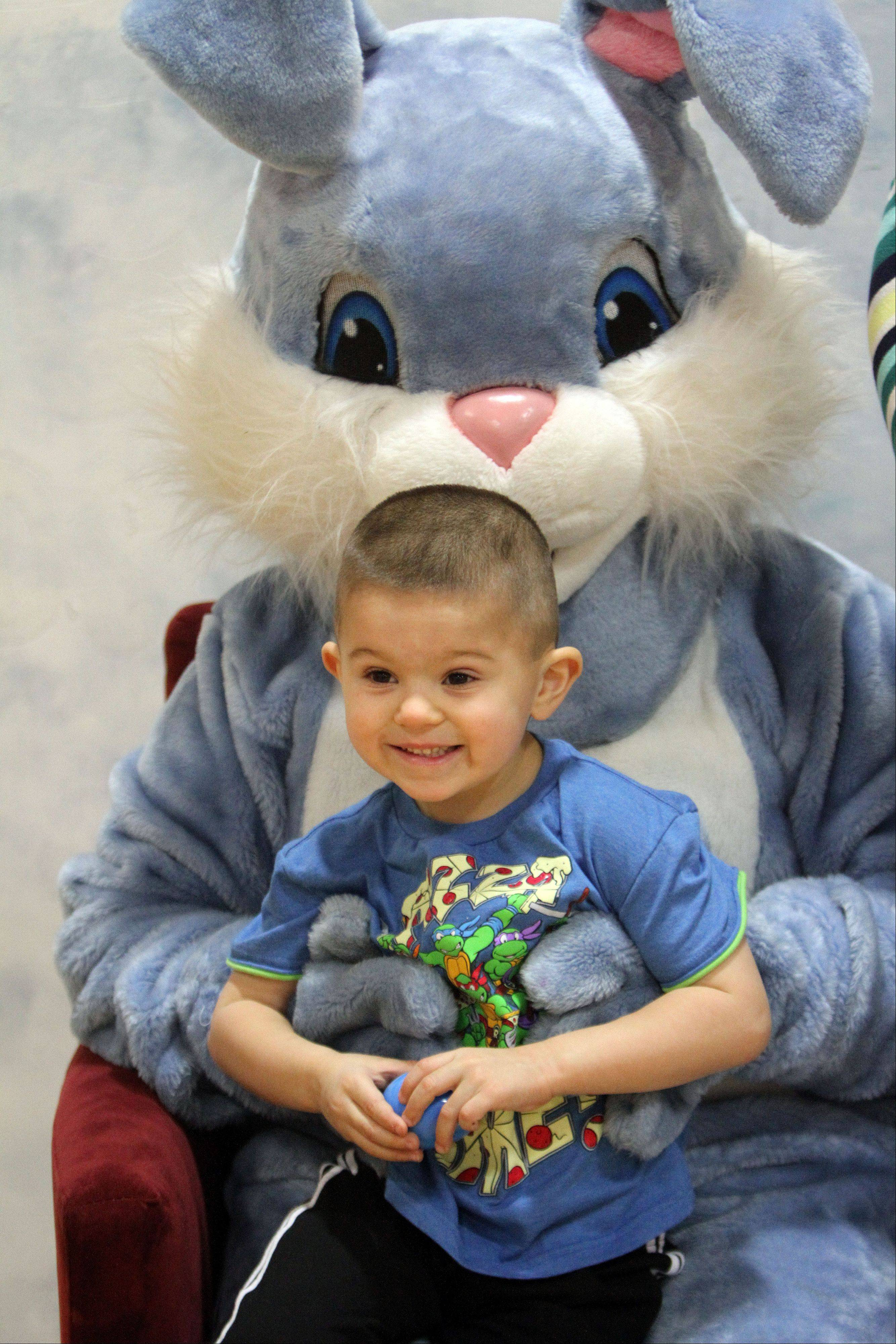 4-year-old Anthony Motisi of Round Lake gets his picture taken with the Mr. Rabbit during Mr. Rabbit's Spring Party at the Robert W. Rolek Community Center in Round Lake Beach Friday.