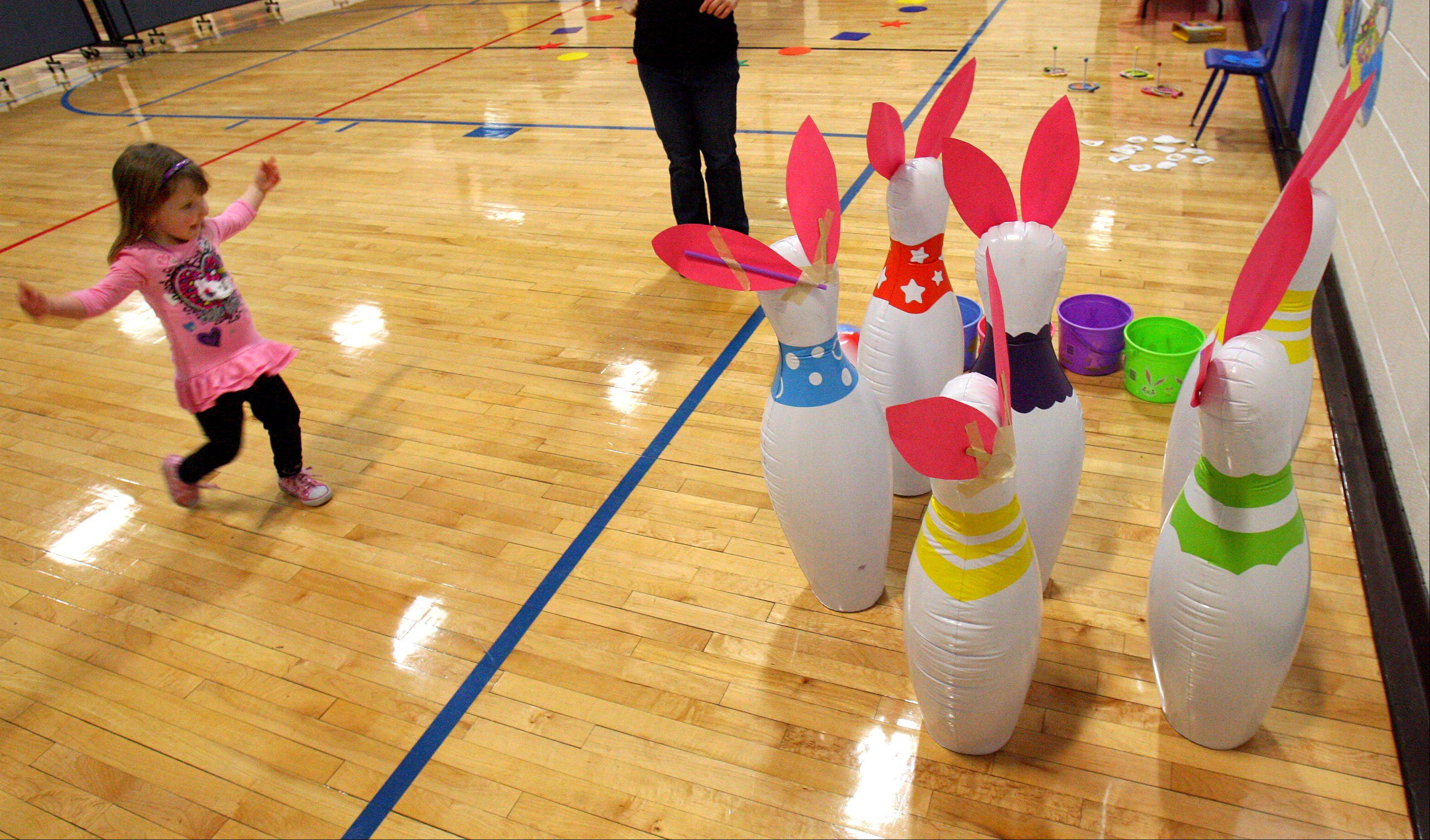 3-year-old Breanne Warren of Spring Grove plays some bunny bowling during Mr. Rabbit's Spring Party at the Robert W. Rolek Community Center in Round Lake Beach Friday.