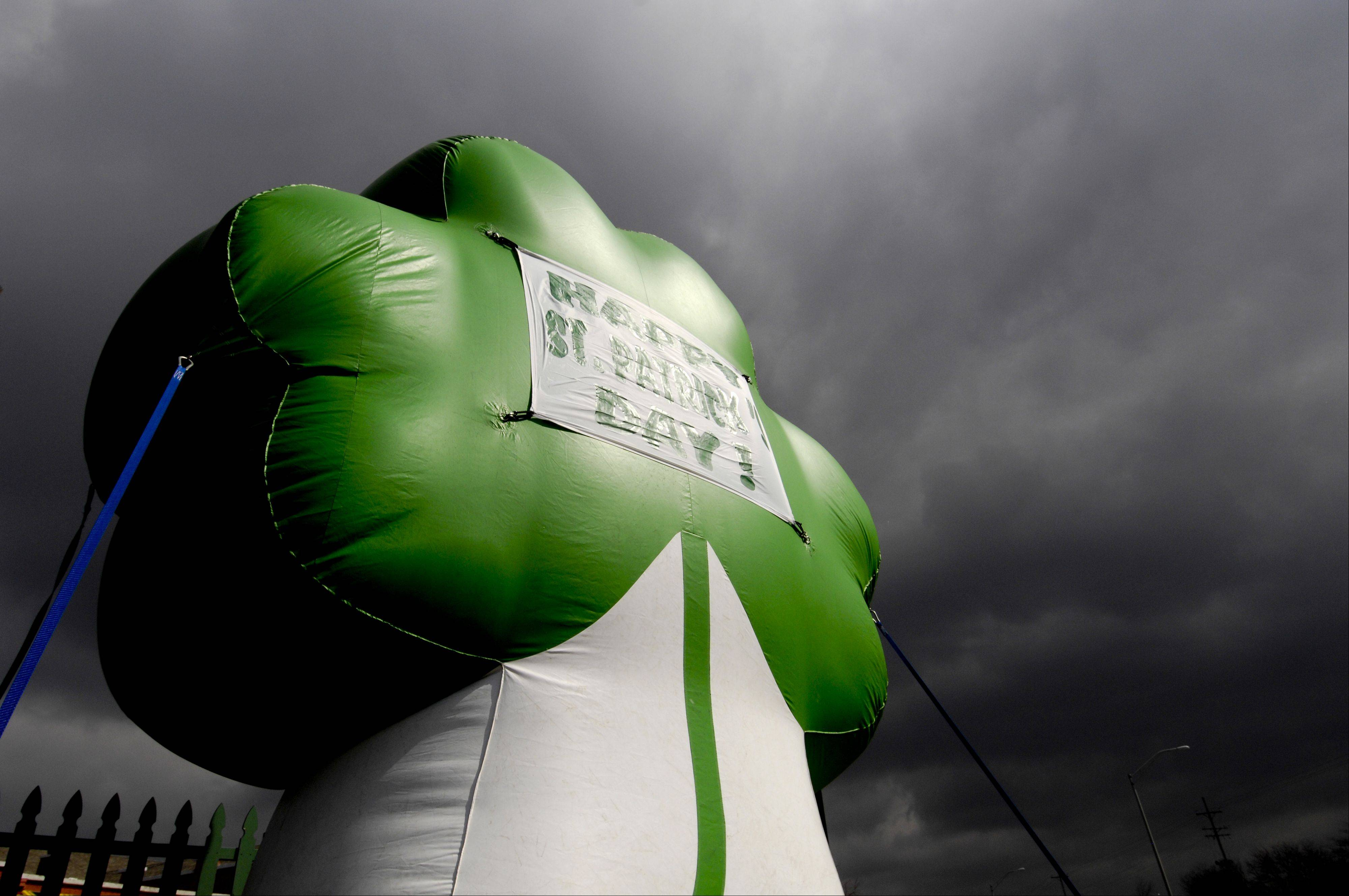 A large inflatable shamrock outside a Lisle bar combined with the ominous clouds and the bright late afternoon sun caught my eye. I used a wide angle lens and a low vantage point to frame the shamrock in the sky without having any buildings in the background.