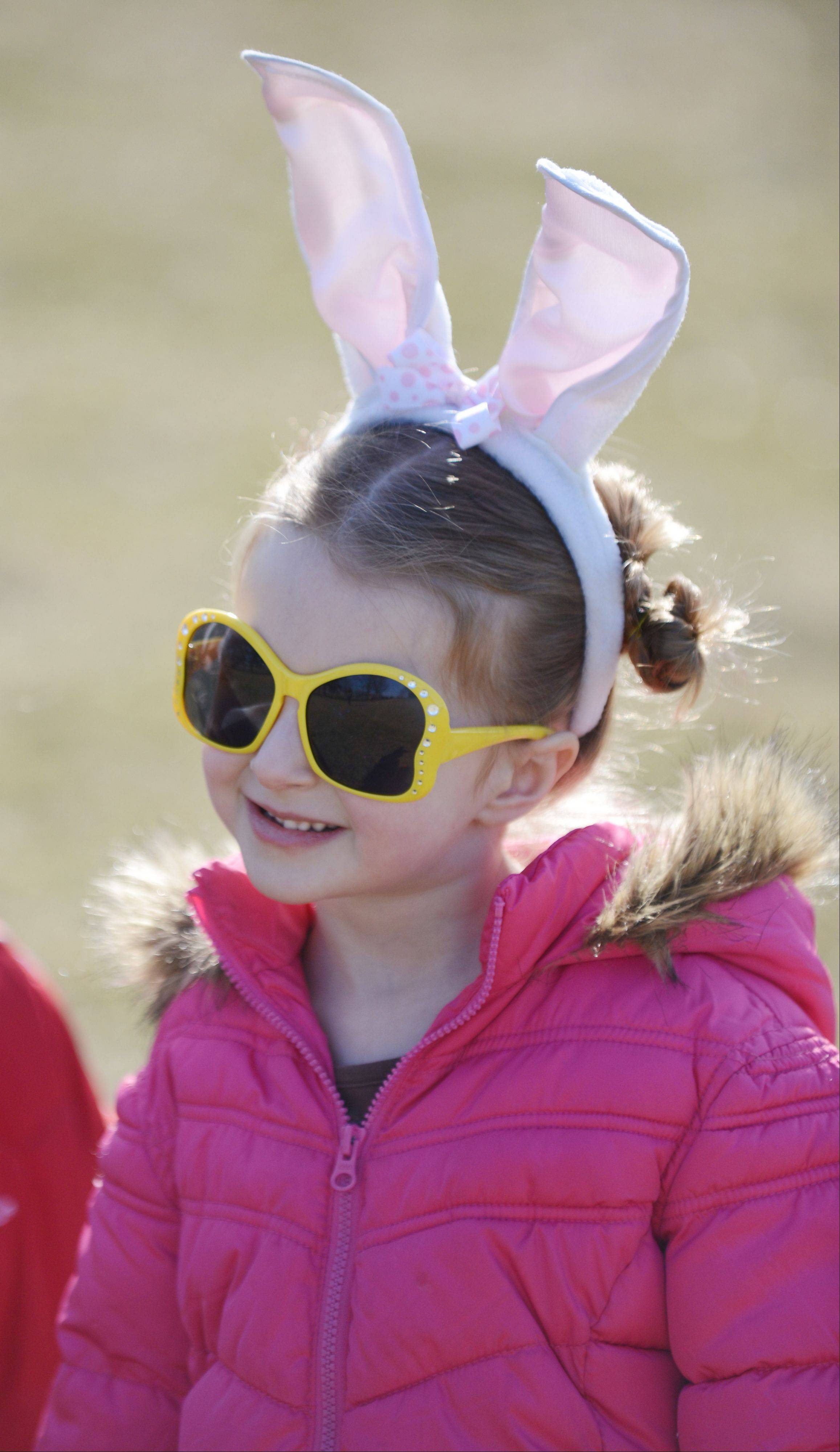 Eden Lougee, 4, of Lisle, is all smiles while she waits for the start of the Lisle Park District annual Easter egg hunt in Community Park.