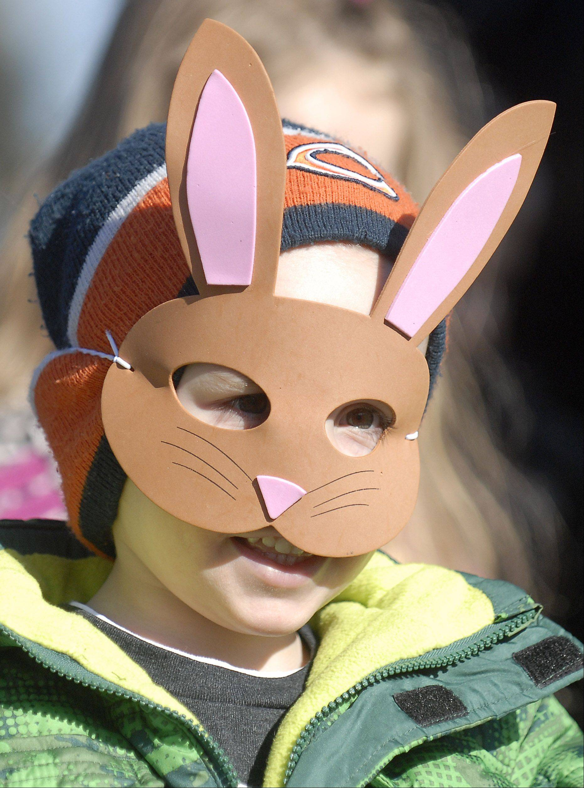 Michael Schero, 4, of St. Charles, patiently waits at the starting line of the St. Charles Park District's Free Easter Egg Hunt at Pottawatomie Park. Given the choice of wearing bunny ears or a bunny mask, Michael decided on the mask, which actually was being worn by garden gnomes in their yard.