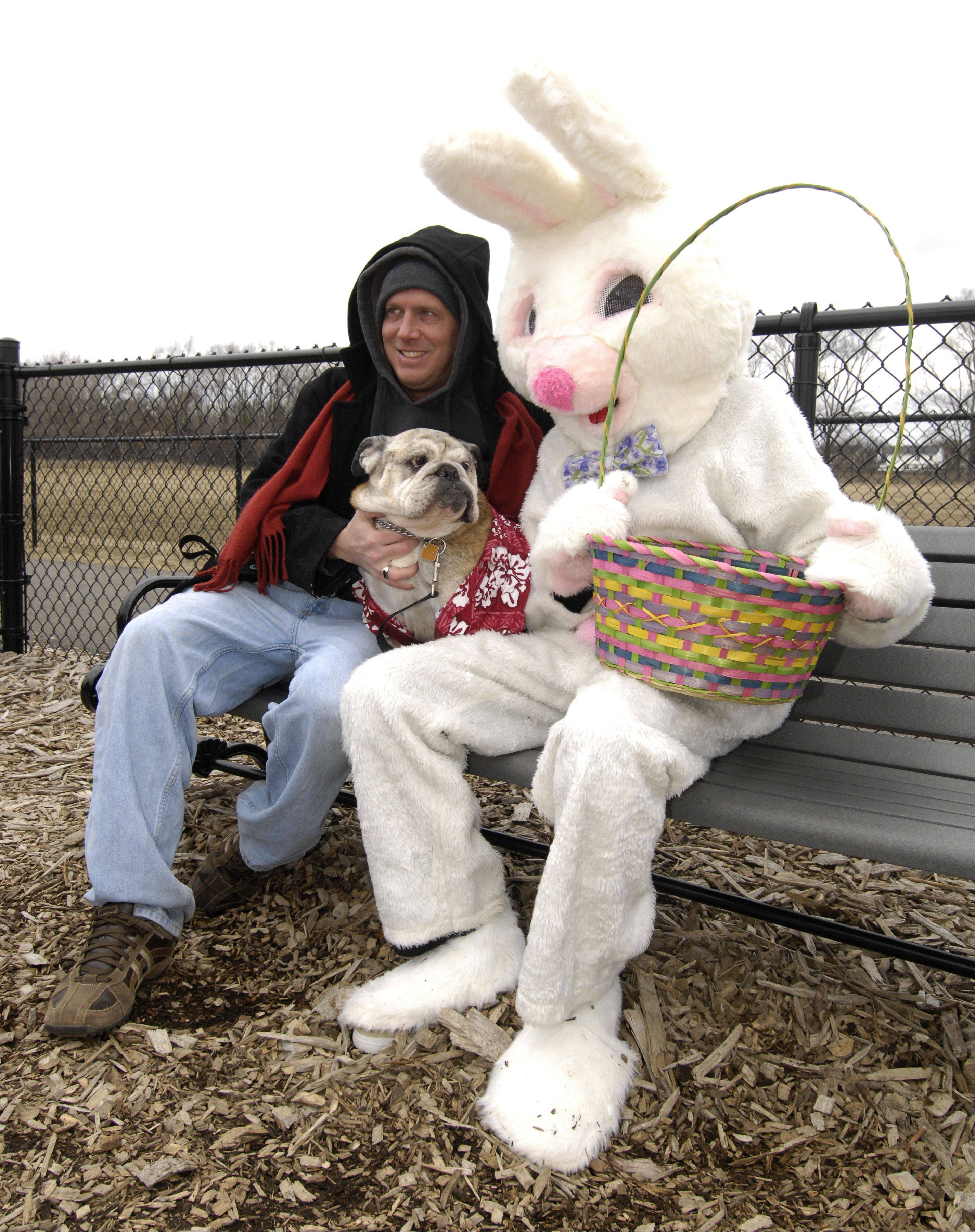 Mike Pudlo and his dog Sergeant Ruphiz pose for a photo with the Easter Bunny during the Carol Stream Park District's egg hunt for dogs at Bark Park, Sunday.