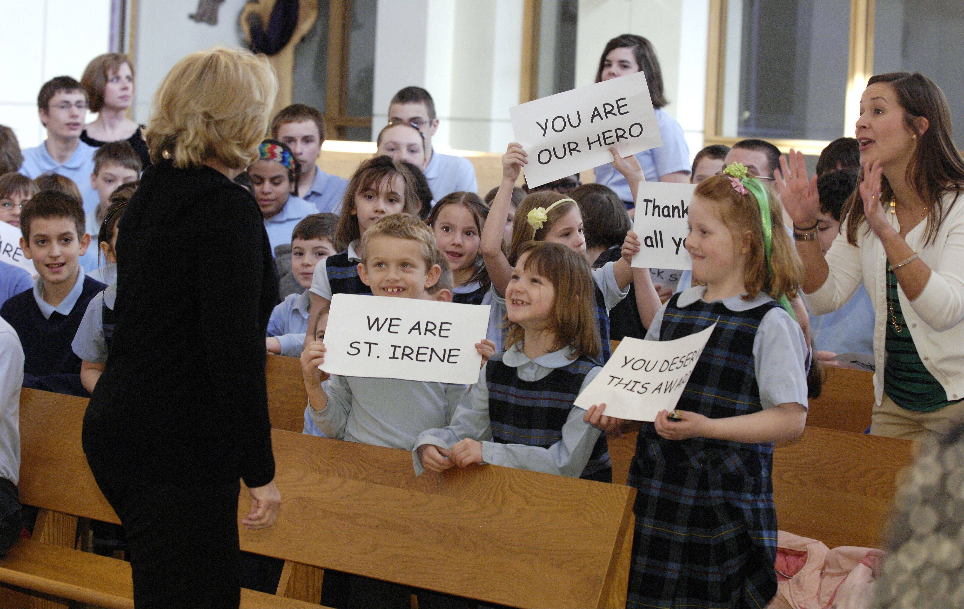 St. Irene School students cheer for their Principal, Maureen White, after she has won the prestigious Diocesan Bishop Kaffer Outstanding Principal Award, Tuesday in Warrenville.