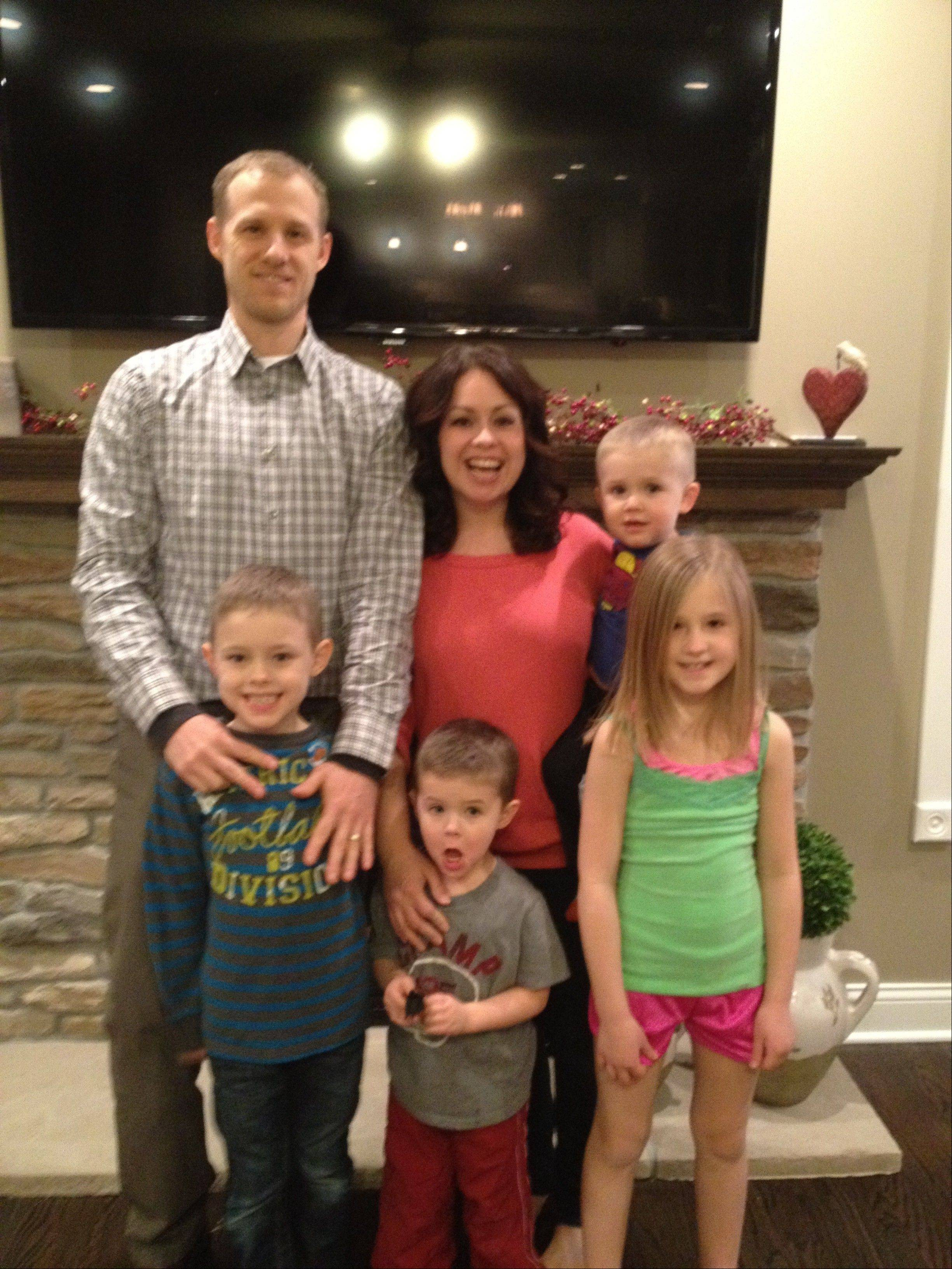 Quick thinking on the basketball court saved Matt Krueger's life when he went into cardiac arrest March 2 in St. Charles. Krueger, 36, of Genoa, is pictured with his wife, Marina, and their children Sydney, 9, John, 7, Cole, 4, and Caleb, 2.