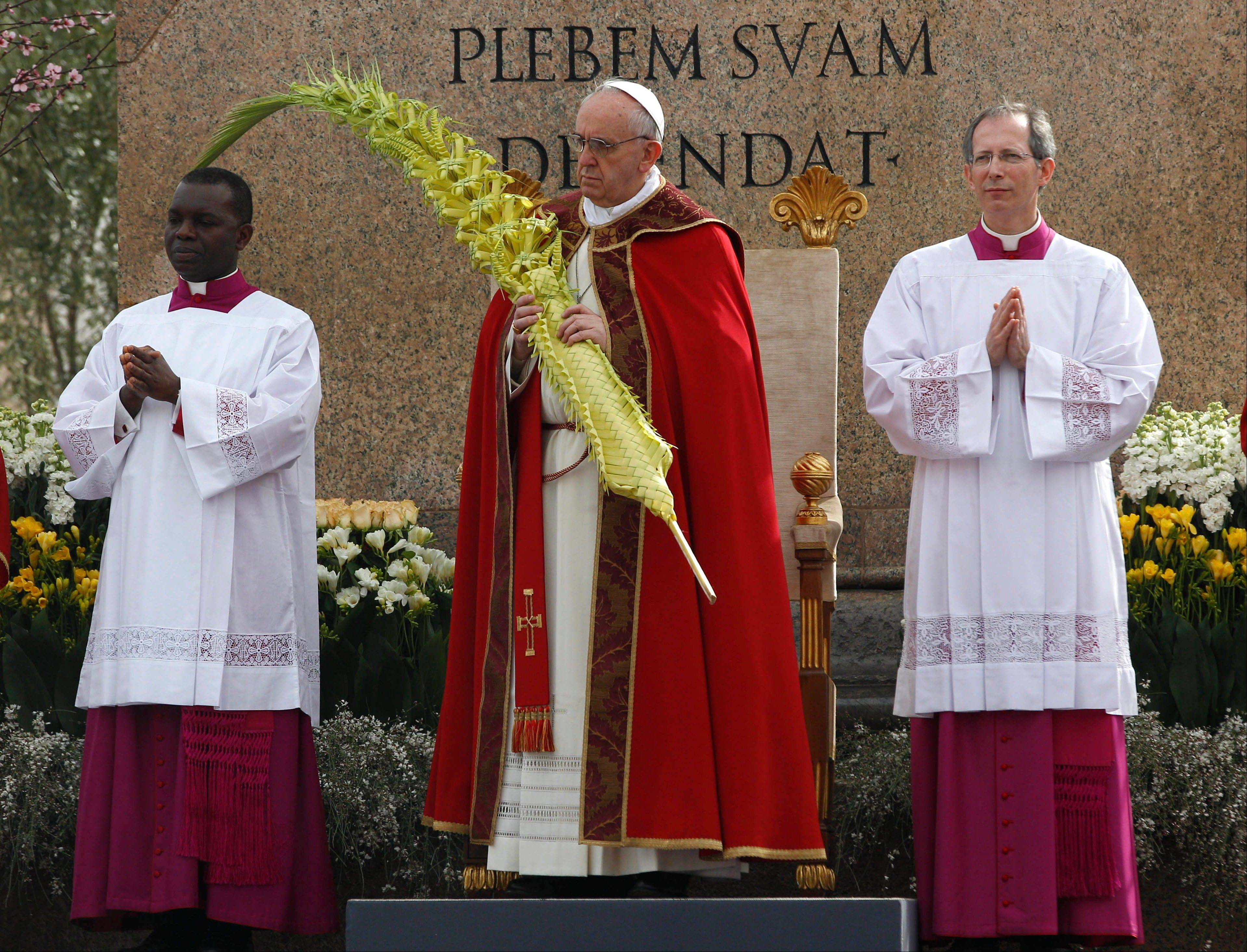Pope Francis celebrates Palm Sunday Mass in St. Peter's Square at the Vatican Sunday.