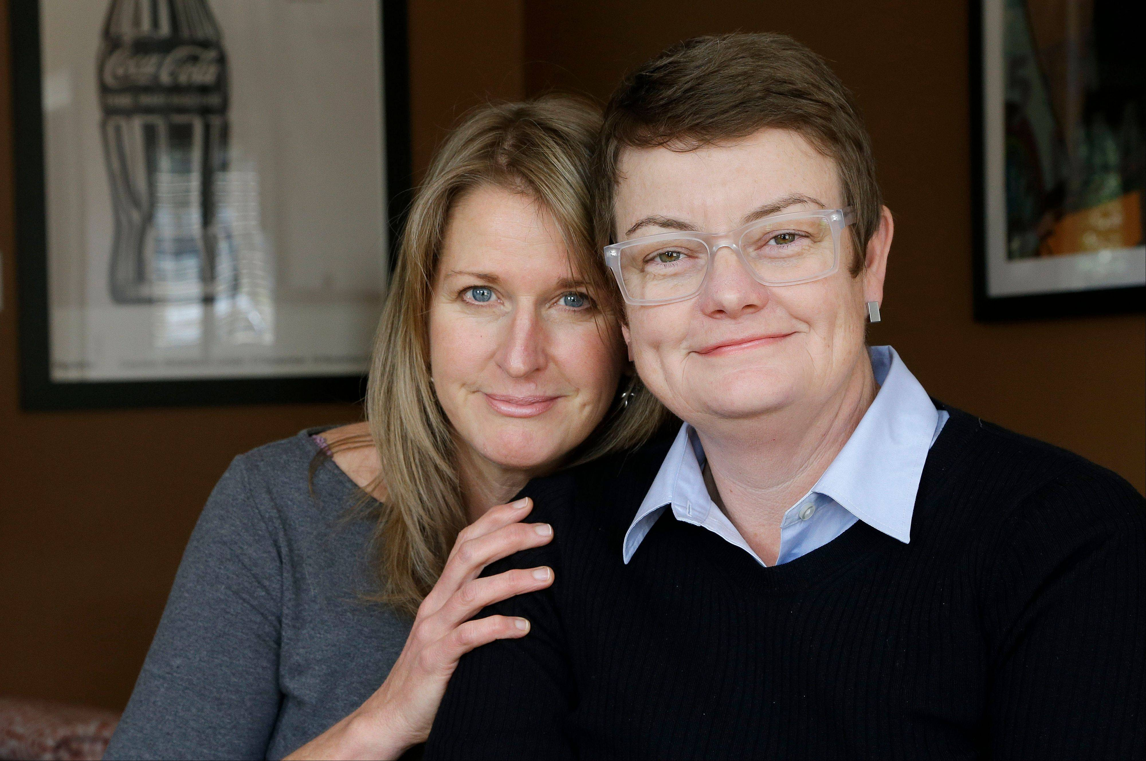Sandy Stier, left, and Kris Perry, the couple at the center of the Supreme Court's consideration of gay marriage, are seen at their home in Berkeley, Calif.