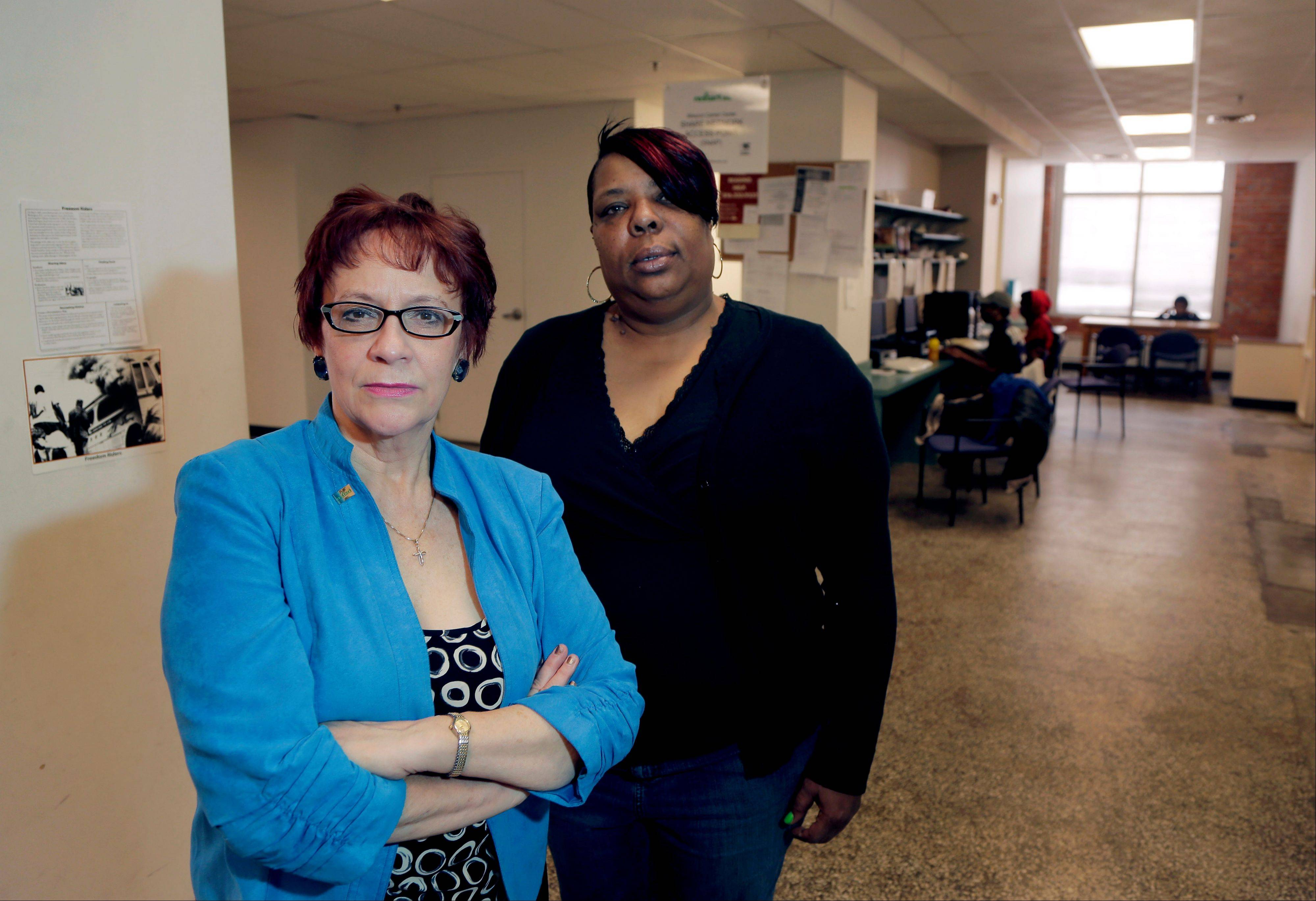 Evelyn Craig, left, executive director of reStart Inc., and LaTonya Jenkins, a reStart client who lives at the facility, pose at the homeless shelter in Kansas City, Mo. The women are concerned that Missouri's refusal to expand Medicaid under the Affordable Care Act will harm residents of the shelter like Jenkins.