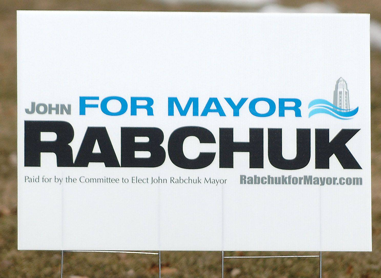 A yard sign for St. Charles mayoral candidate John Rabchuk.