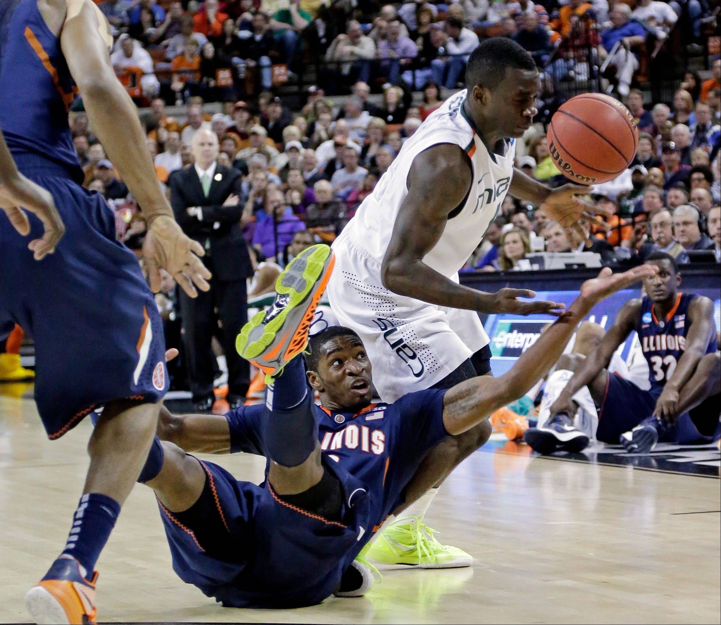 Illinois' Brandon Paul and Miami's Durand Scott battle for a loose ball during the first half of a third-round game of the NCAA college basketball tournament Sunday, March 24, 2013, in Austin, Texas.