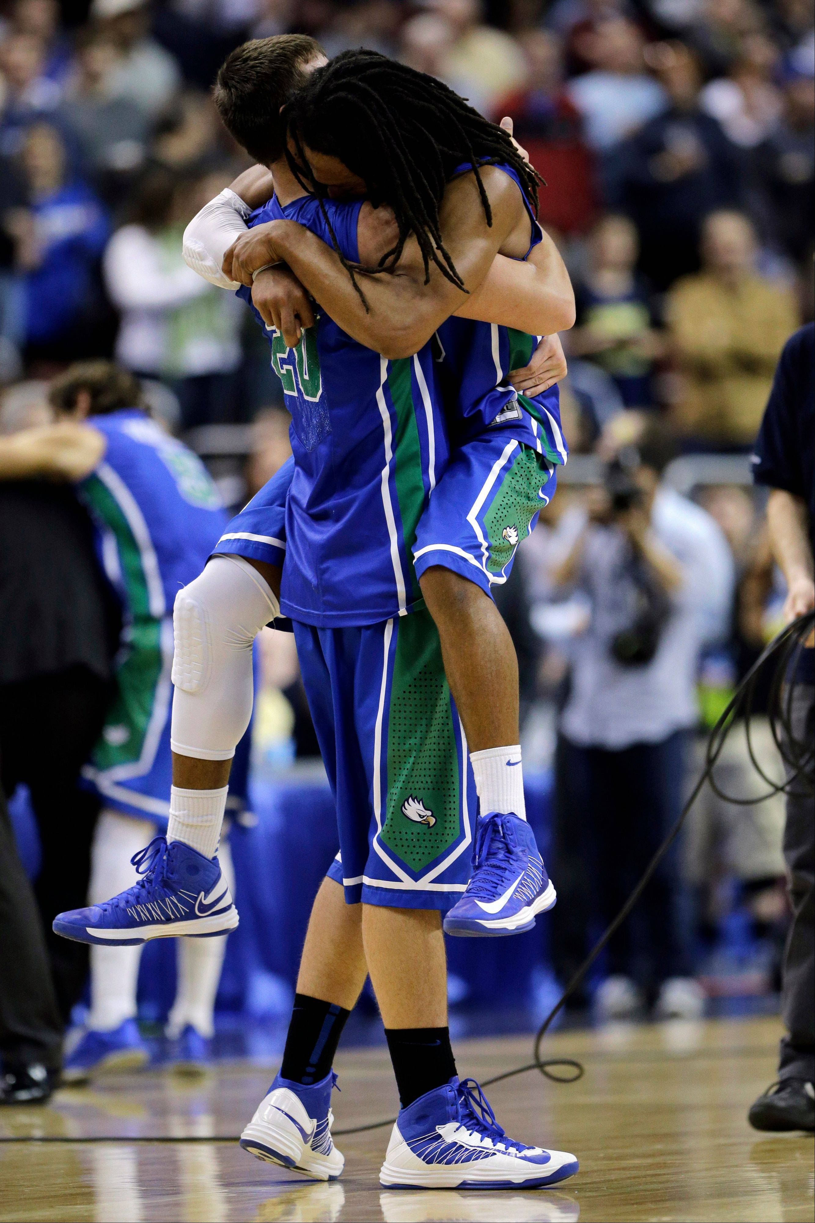 Florida Gulf Coast's Chase Fieler, left, and Sherwood Brown celebrate after winning a third-round game against San Diego State, 81-71, in the NCAA college basketball tournament, Sunday, March 24, 2013, in Philadelphia.