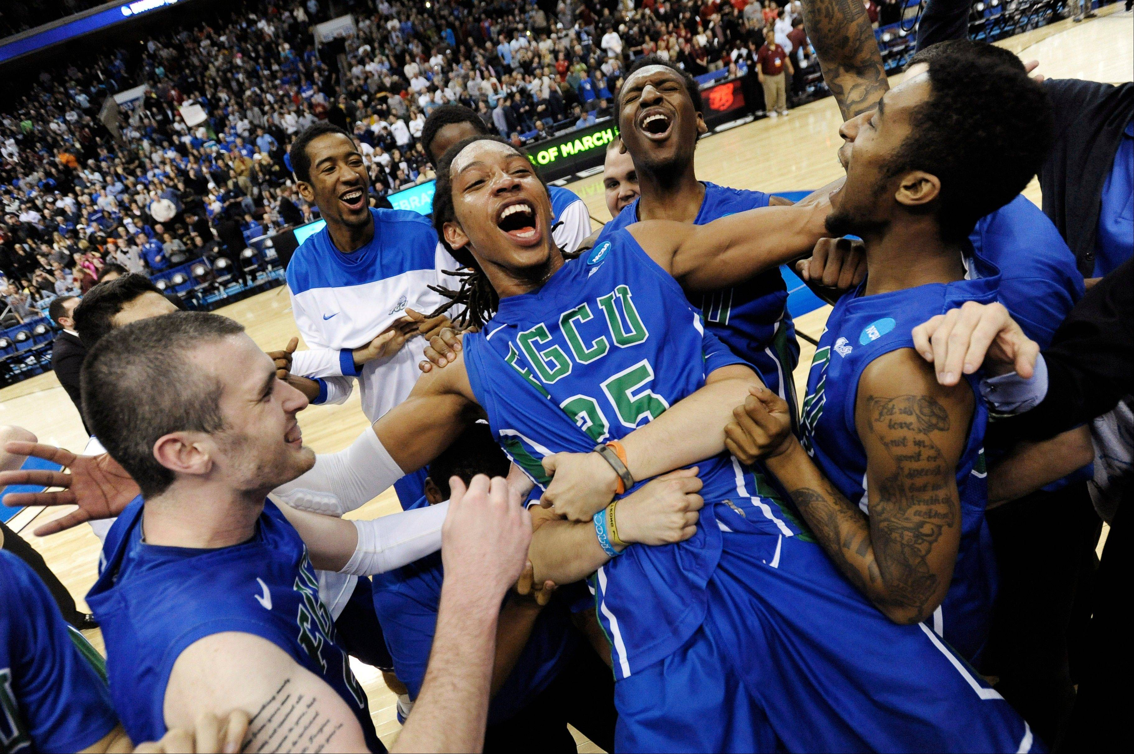 Florida Gulf Coast's Sherwood Brown, center, celebrates with teammates after their 81-71 win over San Diego State in a third-round game in the NCAA college basketball tournament, Sunday, March 24, 2013, in Philadelphia.