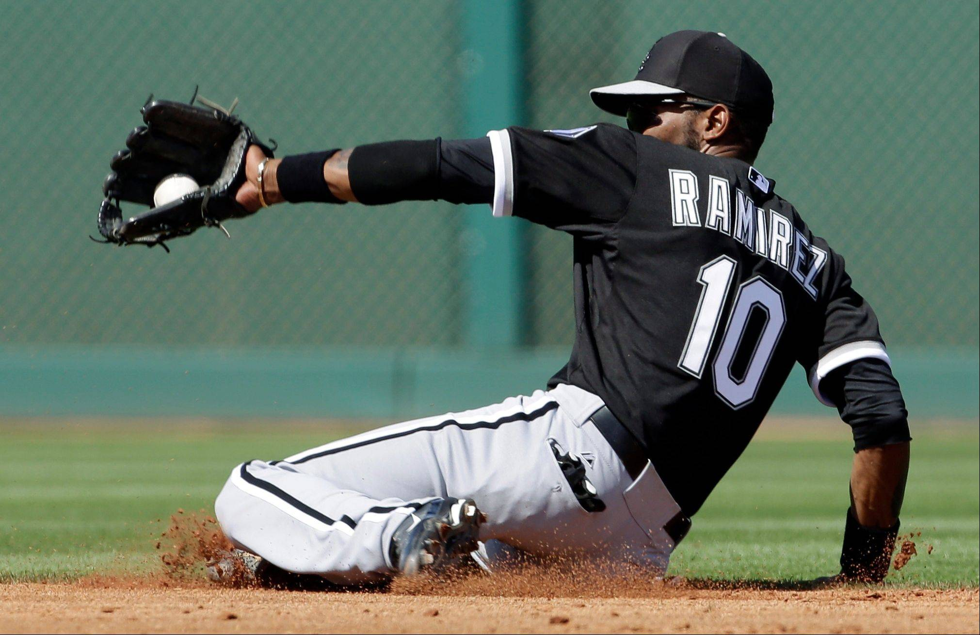 Alexei Ramirez makes a sliding stop on a ground ball by Cincinnati's Devin Mesoraco on March 19 in a spring-training game. With defenders like Ramirez, Jeff Keppinger and Gordon Beckham, the White Sox figure to have another strong team defensively in 2013.