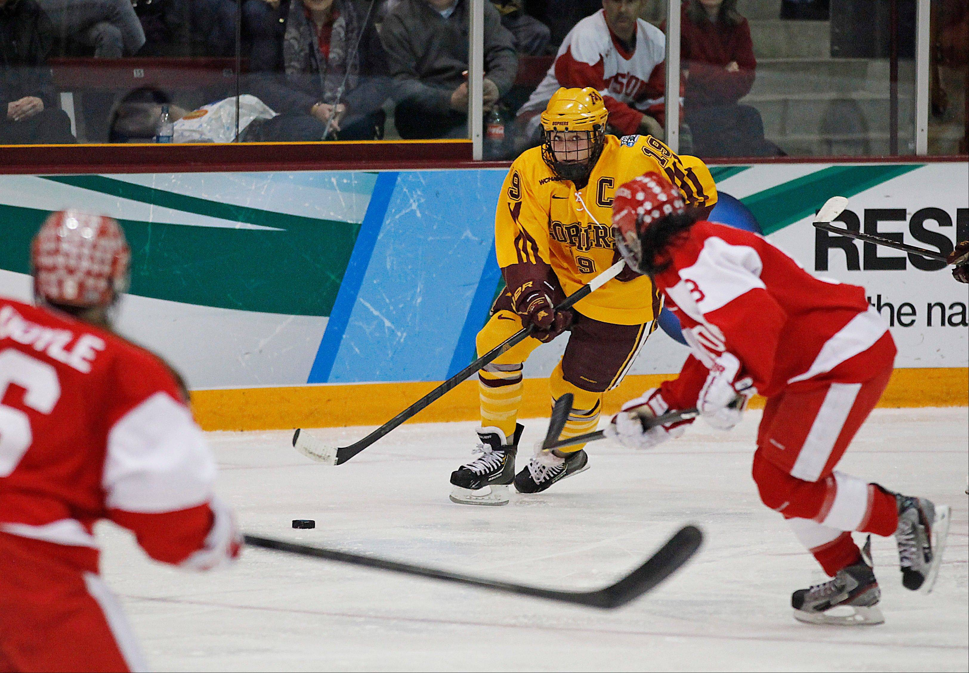 Minnesota defender and Buffalo Grove native Megan Bozek looks to pass against Boston University in the women's Frozen Four NCAA Championship college hockey game Sunday in Minneapolis.