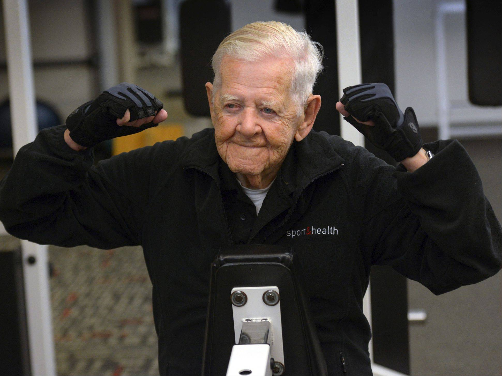 Ray Clark celebrates completion of his weekly workout. At 102, Clark is living proof that it's never too late to get fit.