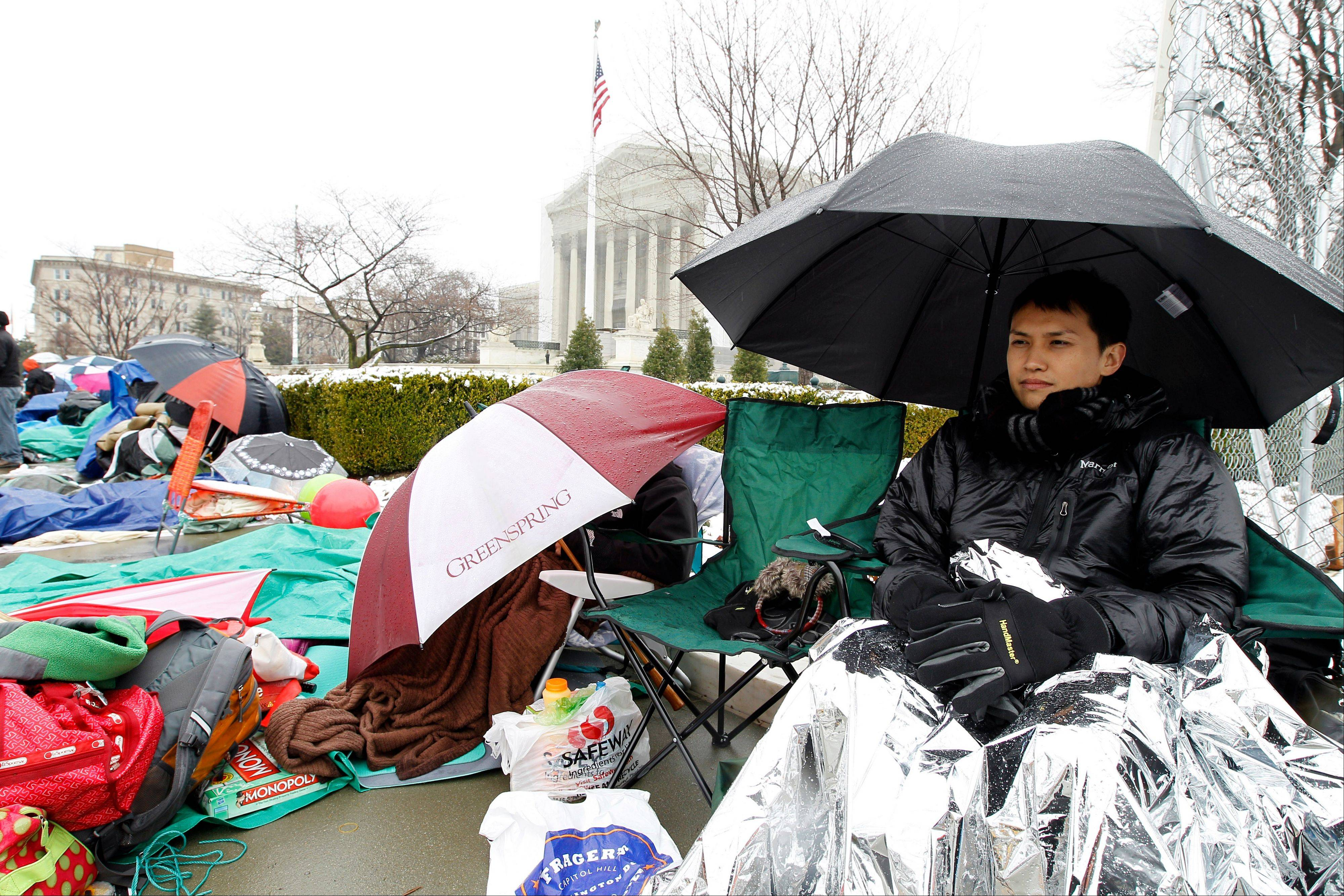 Wally Suphap from California waits in line to enter Supreme Court in Washington Monday, a day before the court will hear a same-sex marriage case.