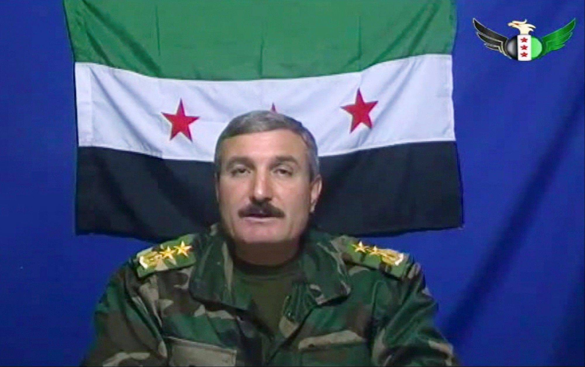 Syrian Commander Riad al-Asaad, a rebel military leader who was among the first to call openly for armed insurrection against President Bashar Assad, was wounded by a bomb planted in his car in eastern Syria, rebels and activists said Monday.