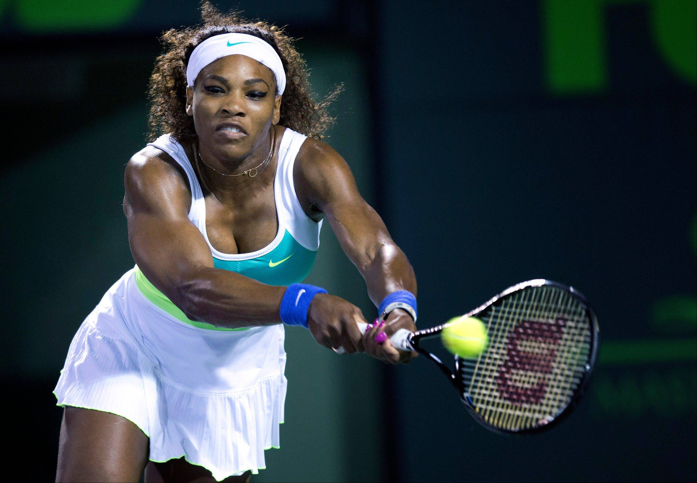Serena Williams returns the ball to Ayumi Morita, of Japan, during the Sony Open tennis tournament, Saturday, March 23, 2013, in Key Biscayne, Fla. (AP Photo/J Pat Carter)