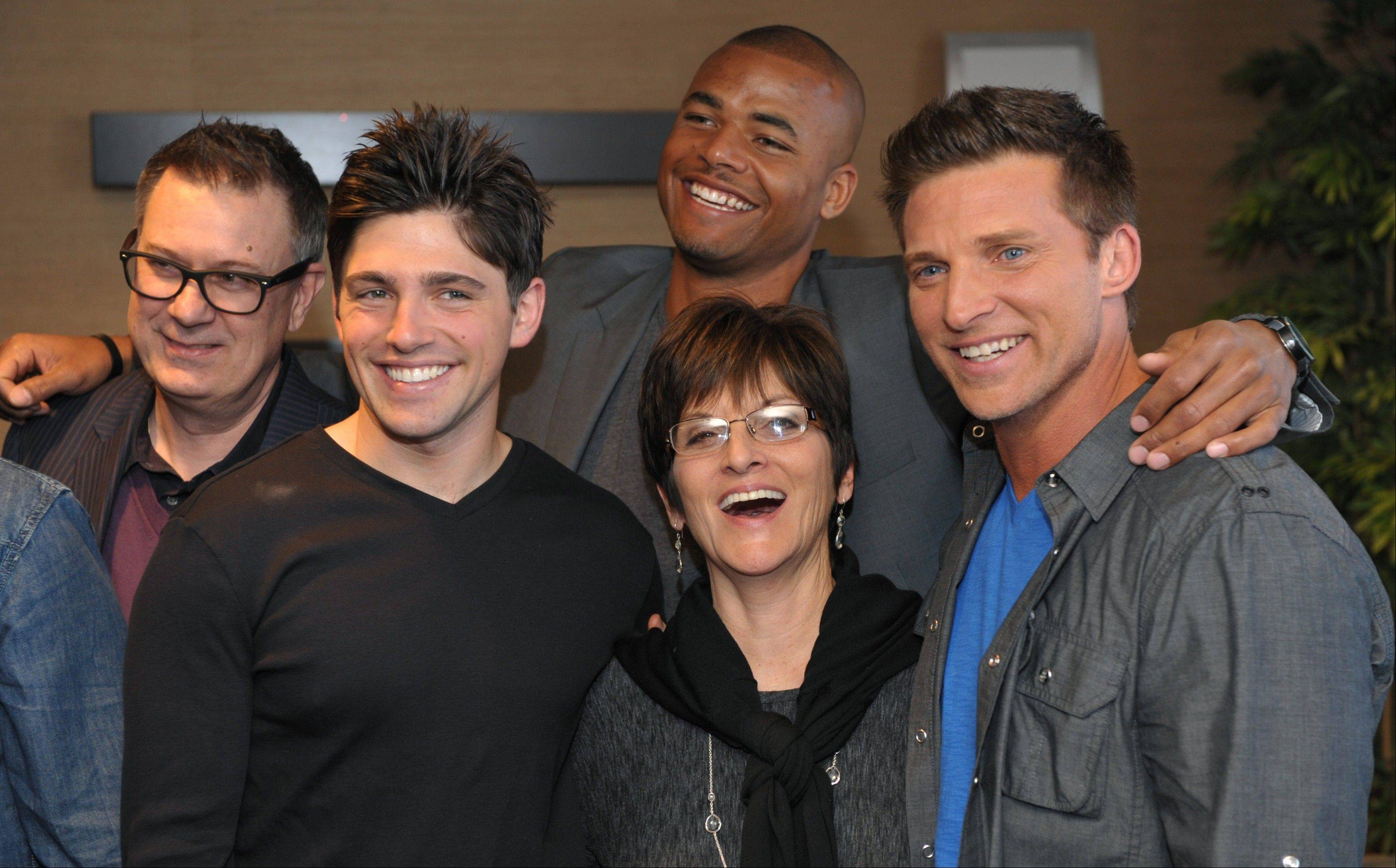 "Jill Farren Phelps, second from right, executive producer of ""The Young and the Restless,"" poses with, from left, the show's head writer Josh Griffith and cast members Robert Adamson, Redaric Williams and Steve Burton at the Hot New Faces of ""The Young and the Restless"" press junket at CBS Television City on Wednesday, Feb. 27, 2013 in Los Angeles. The CBS show, daytime's top-rated soap since December 1988, hits the big 4-0 on Tuesday, March 26, 2013."