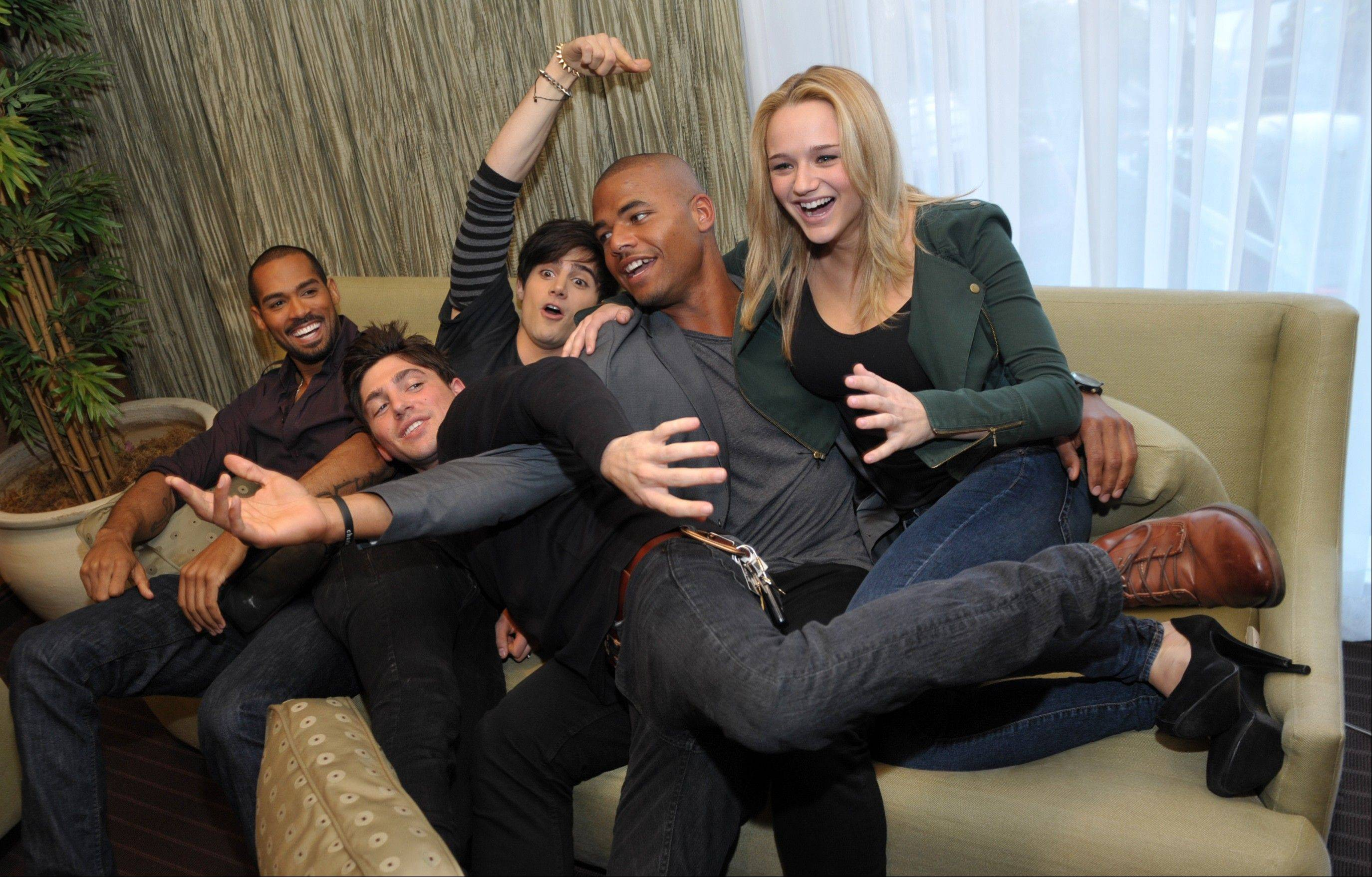 "From left, Lamon Archey, Robert Adamson, Max Ehrich, Redaric Williams and Hunter King, cast members in ""The Young and the Restless,"" are pictured together during the Hot New Faces of ""The Young and the Restless"" press junket at CBS Television City on Wednesday, Feb. 27, 2013 in Los Angeles. The CBS show, daytime's top-rated soap since December 1988, hits the big 4-0 on Tuesday, March 26, 2013."