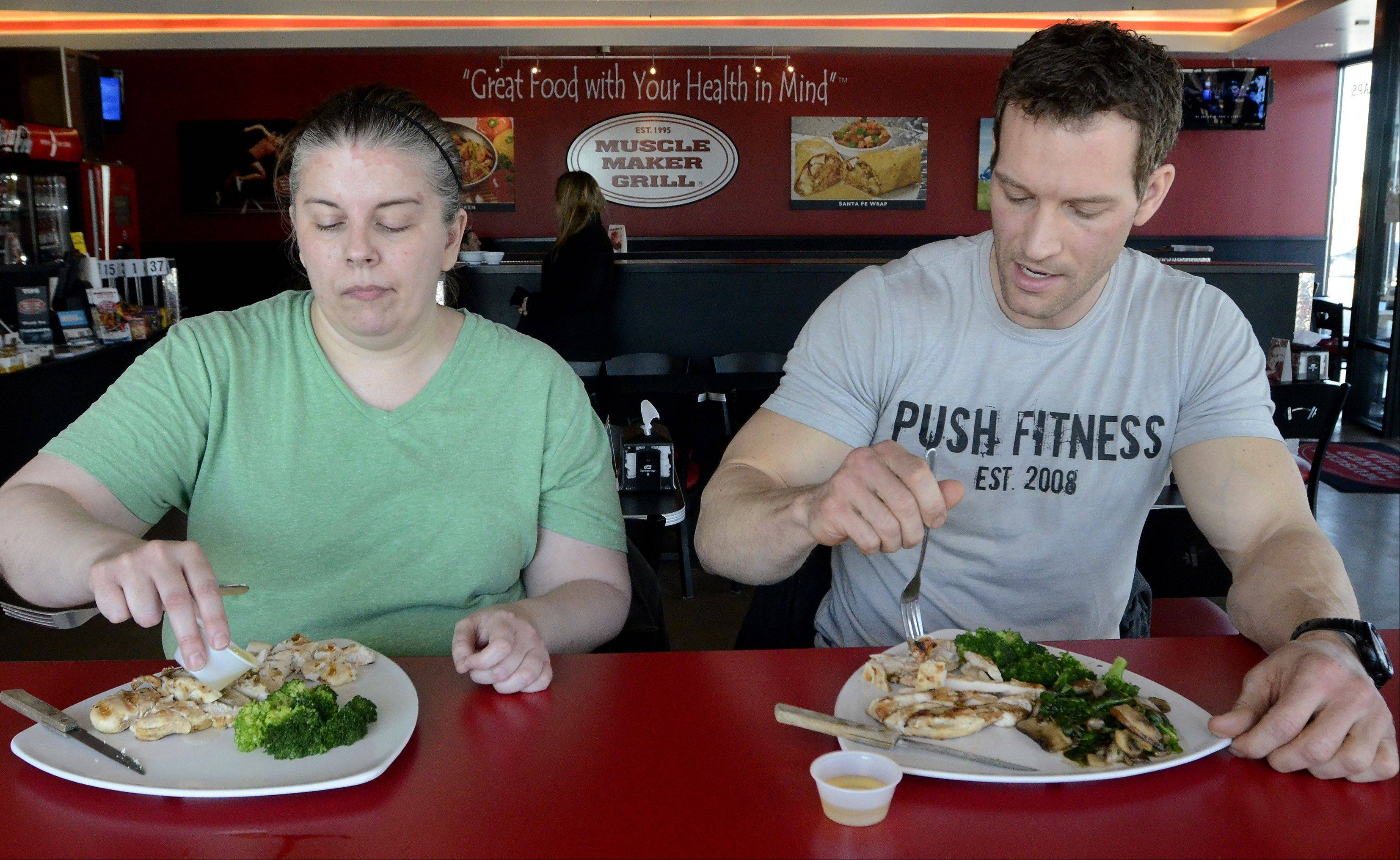 Push Fitness trainer Joshua Steckler and Melynda Findlay eat lunch at Muscle Maker Grill in Rolling Meadows.