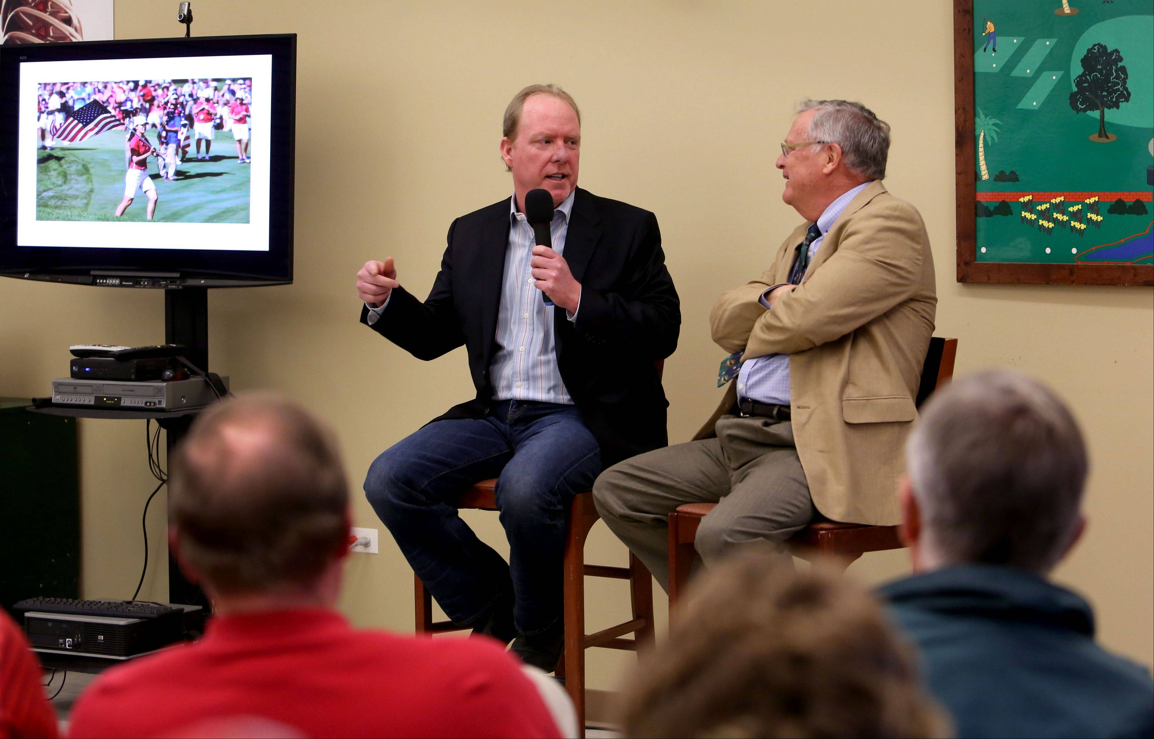 Daily Herald sports writer Mike Spellman, left, and golf columinst Len Ziehm answer questions during the Subscriber Total Access event Monday at the Cantigny Golf Academy at Cantigny Park in Wheaton.