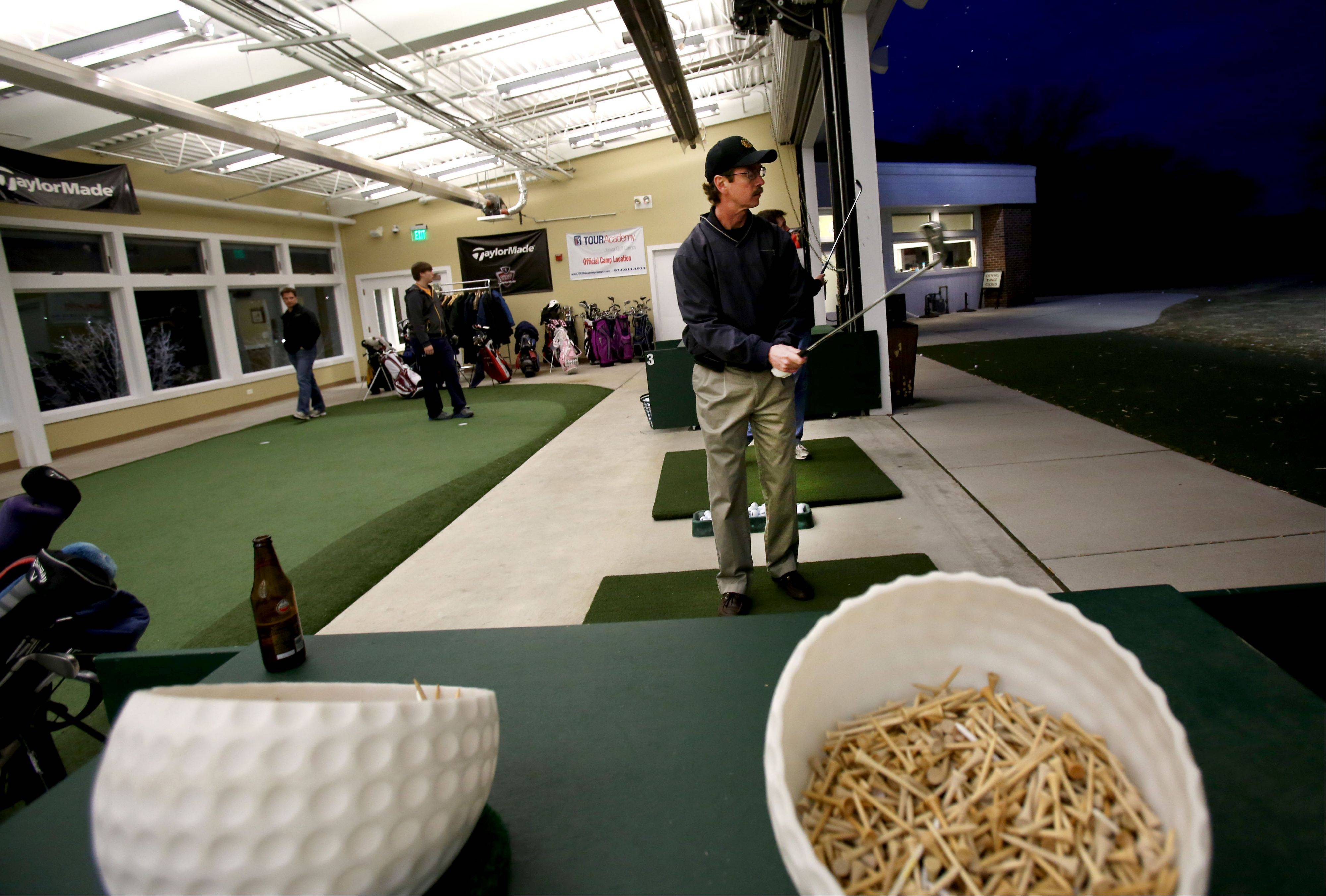 John Ryan of Hannover Park uses the driving range during the Daily Herald Subscriber Total Access event Monday at the Cantigny Golf Academy at Cantigny Park in Wheaton.