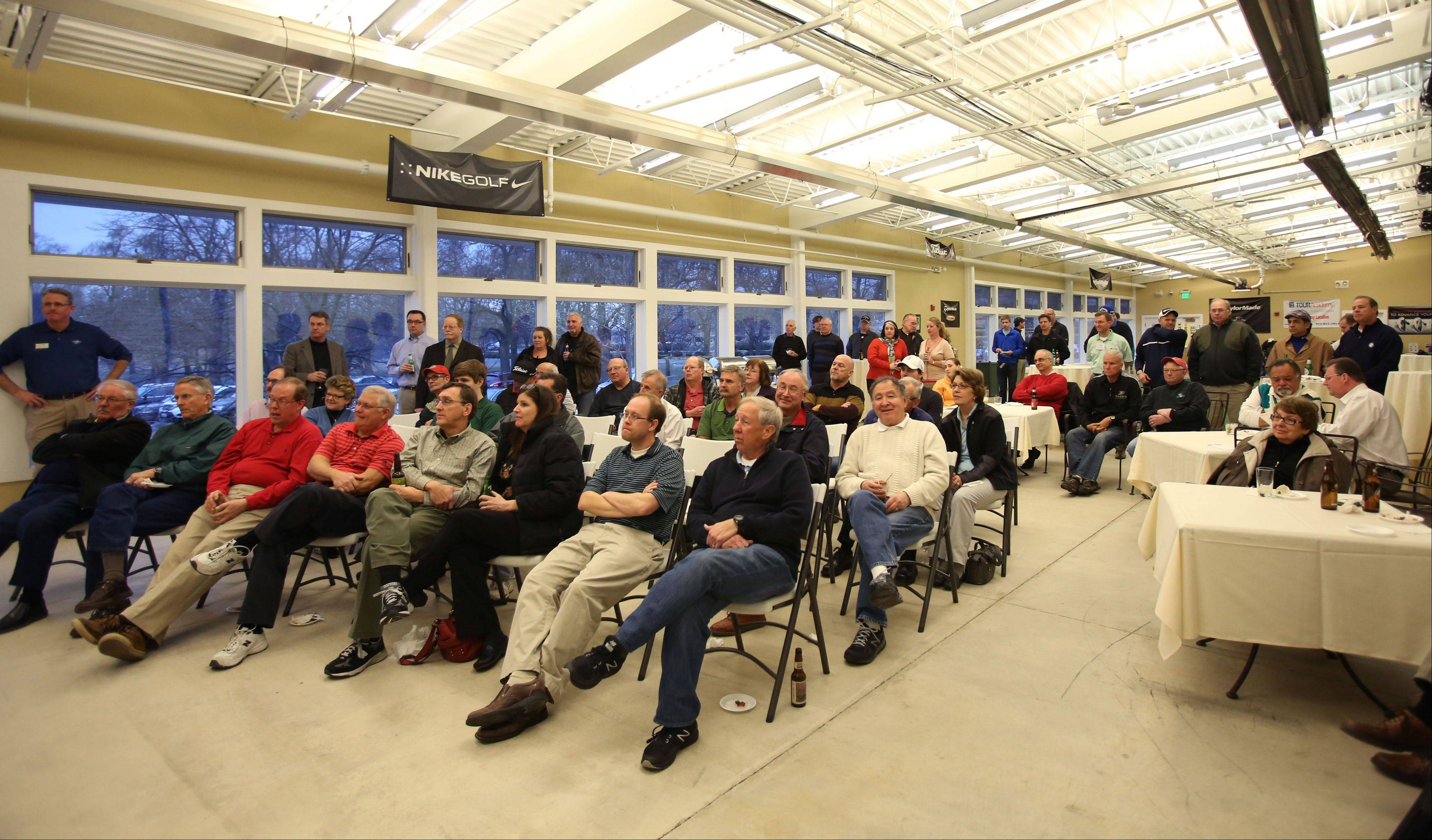 Participants listen to the speakers during the Subscriber Total Access event Monday at the Cantigny Golf Academy at Cantigny Park in Wheaton.
