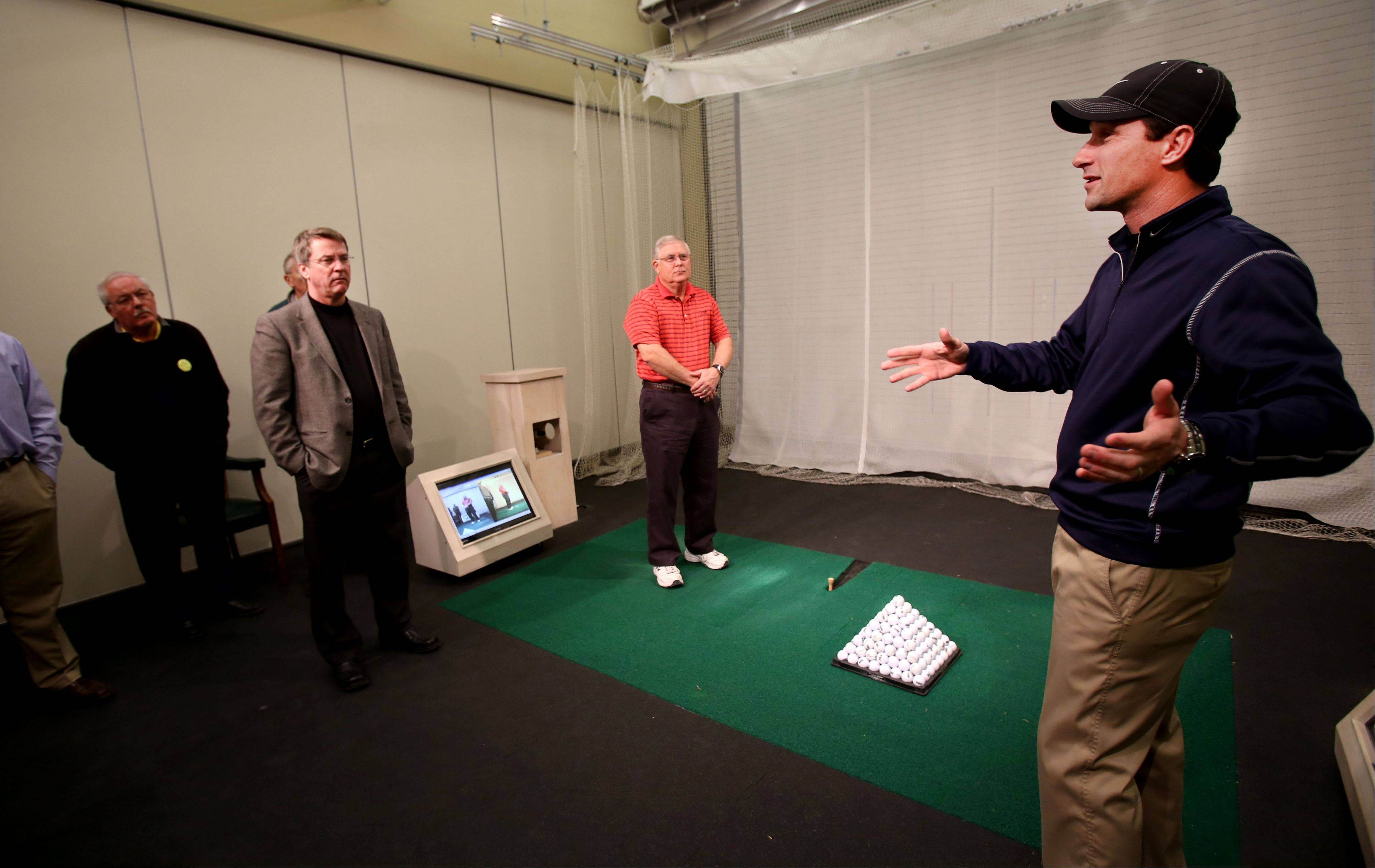 PGA teaching professional Jason Hyatt shows the swing analysis room to guests of the Subscriber Total Access event Monday at the Cantigny Golf Academy at Cantigny Park in Wheaton.