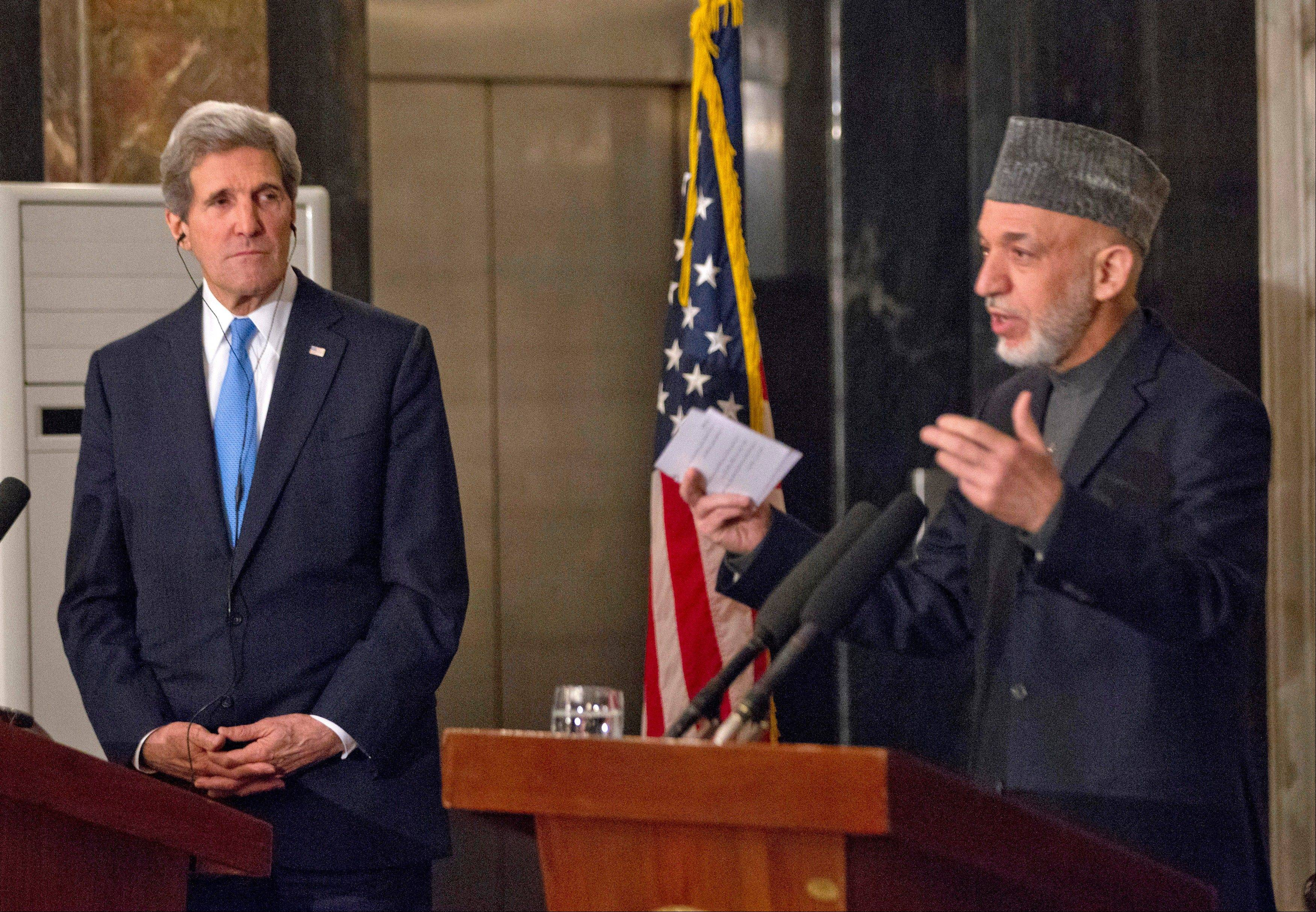 "Secretary of State John Kerry and Afghan President Hamid Karzai made a show of unity Monday in Kabul. Kerry said he and Karzai were ""on the same page"" when it comes to peace talks with the Taliban."