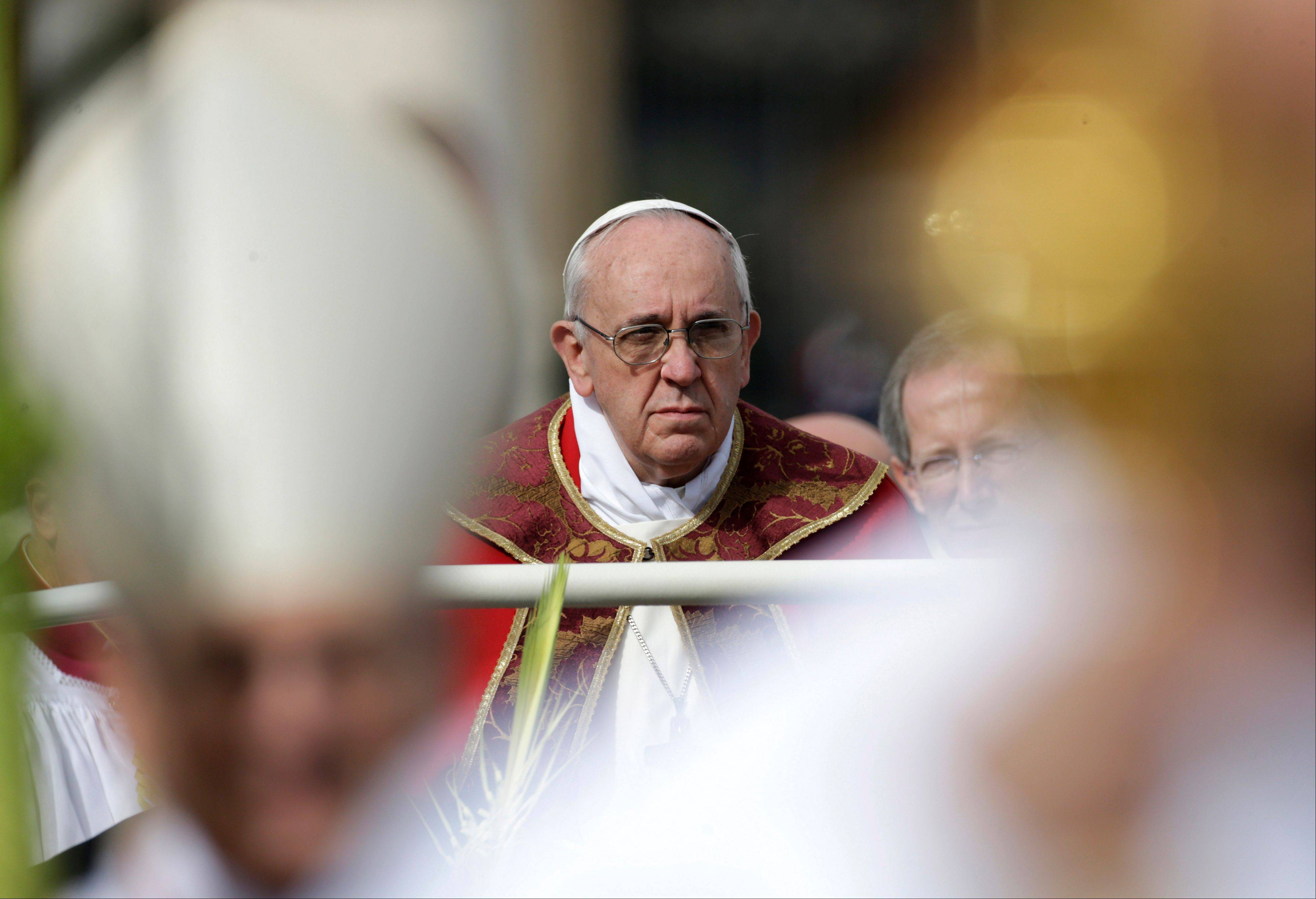 Pope Francis arrives to celebrate Mass on Palm Sunday in St. Peter's Square.