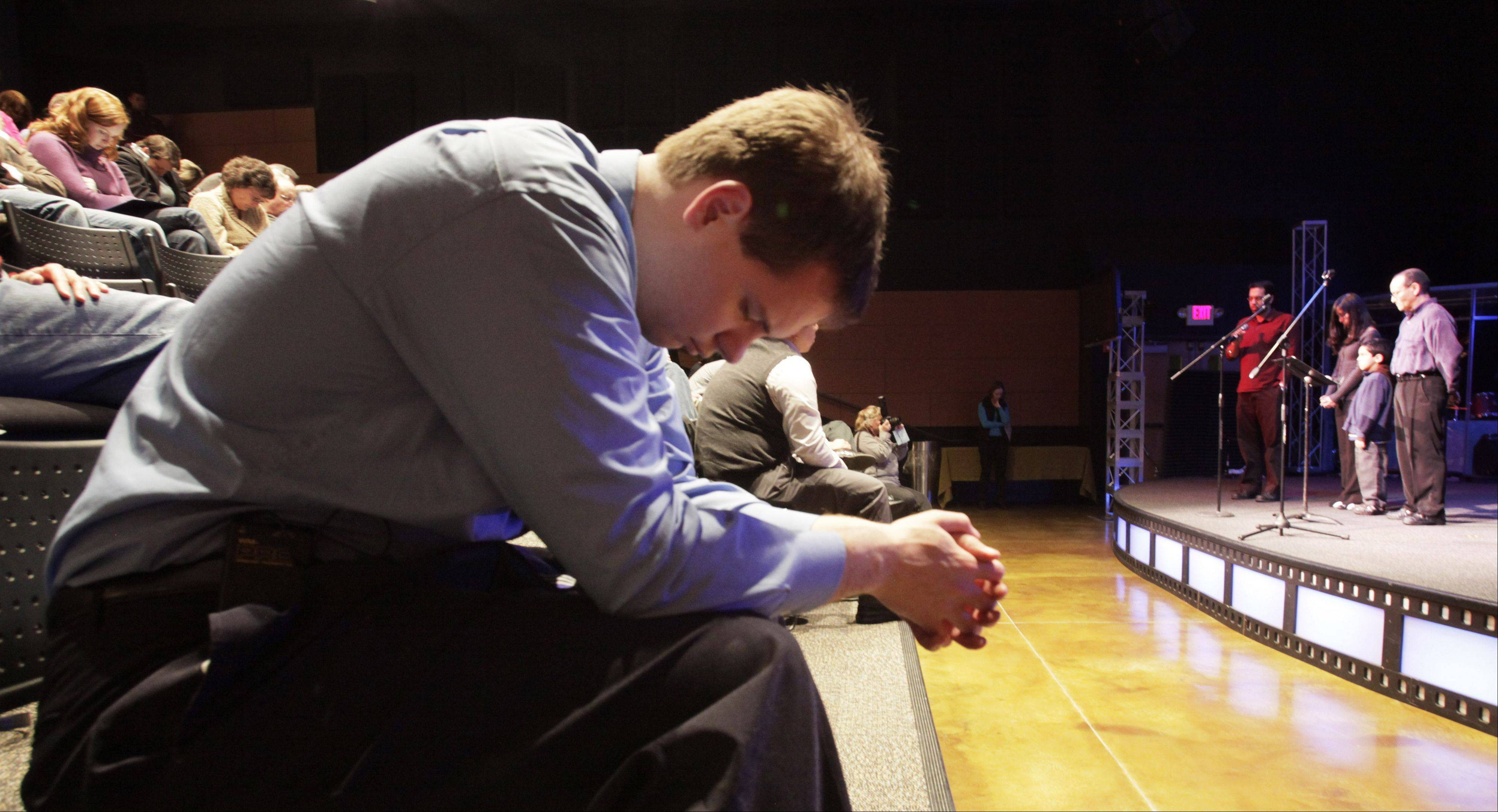 Matthew Soerens of Glen Ellyn prays in February 2010 after making a presentation in Naperville before church pastors and laymen on the topic of biblical perspectives on immigration.