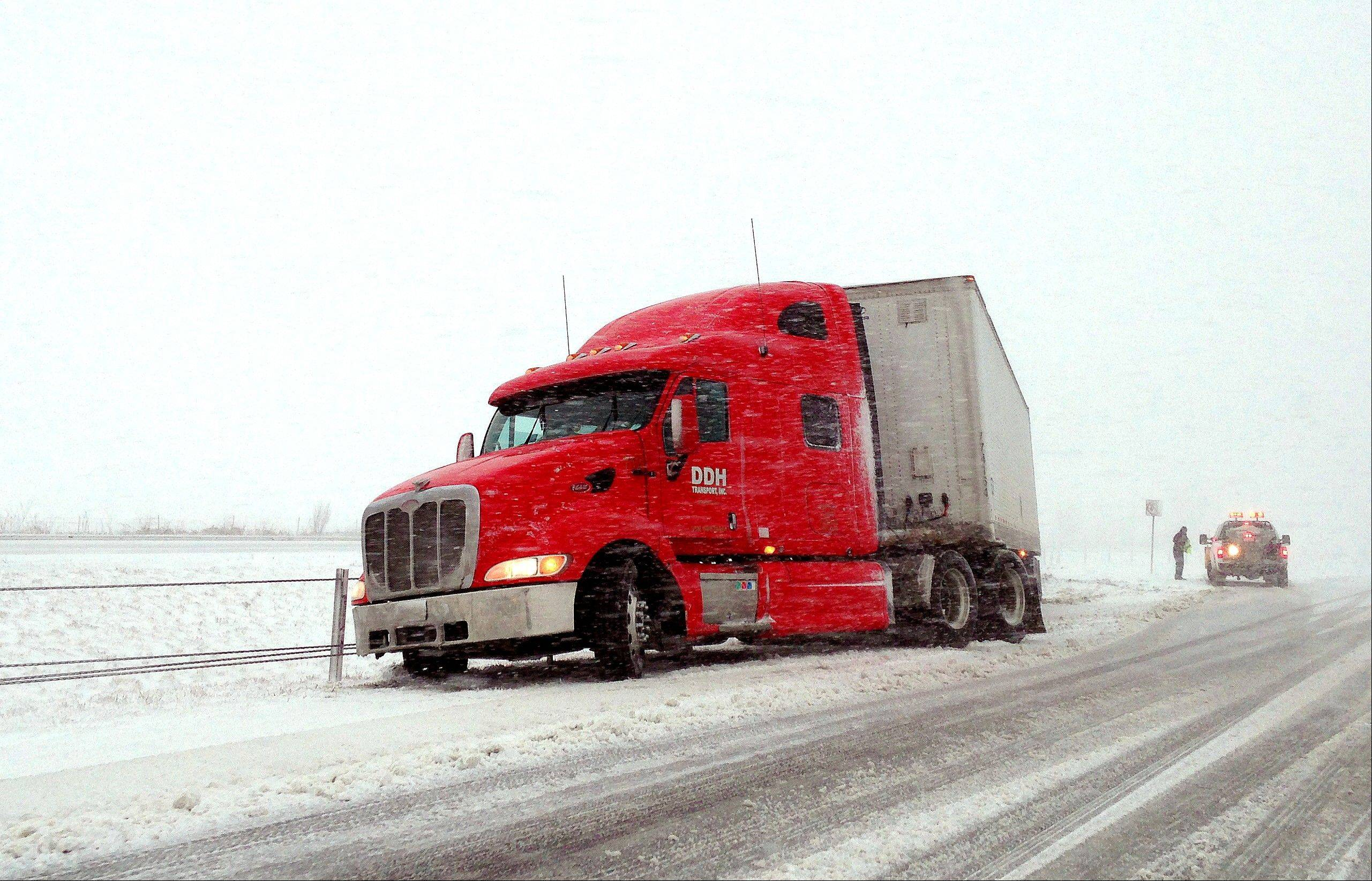 A southbound semitrailer comes to a stop after crossing over into the north bound lanes at mile marker 153 as snow falls near Frankfort, Ind. on Sunday, March 24, 2013. A pair of cars were also involved in the crash but not pictured.