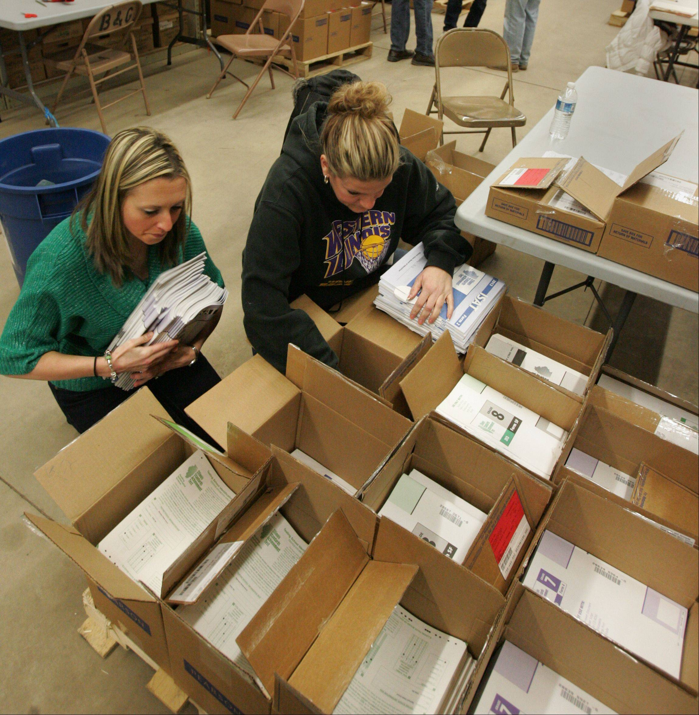 Employees of Carpentersville-based Community Unit District 300 prepare ISAT booklets to be shipped out for grading. Students across the state completed testing March 15, and scores will be released next fall -- with likely disappointing results because of new grading procedures and a tougher standardized test.