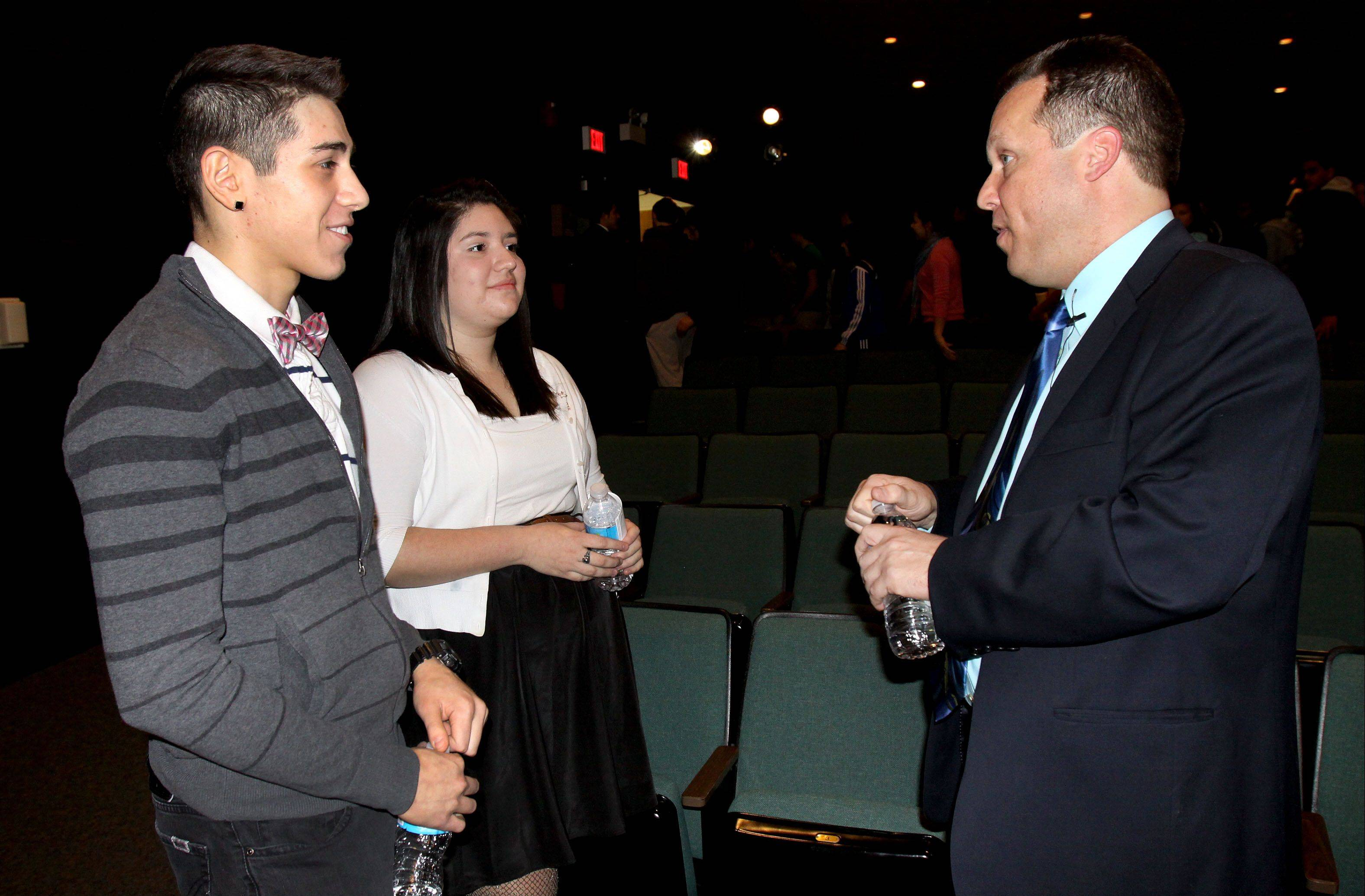 Nick Falco, Fenton High School Class of 1983, chats with seniors Jose Diaz and Stephanie Medina. Falco, a junior varsity coach for Fenton's boys and girls junior varsity soccer teams, was placed on the school's Wall of Fame for his work as a global philanthropist.